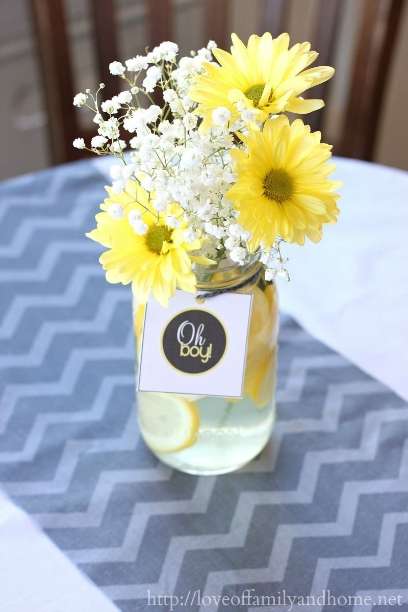 10 Fabulous Baby Shower Flower Centerpiece Ideas gray and yellow baby shower decorating ideas via tonya love of