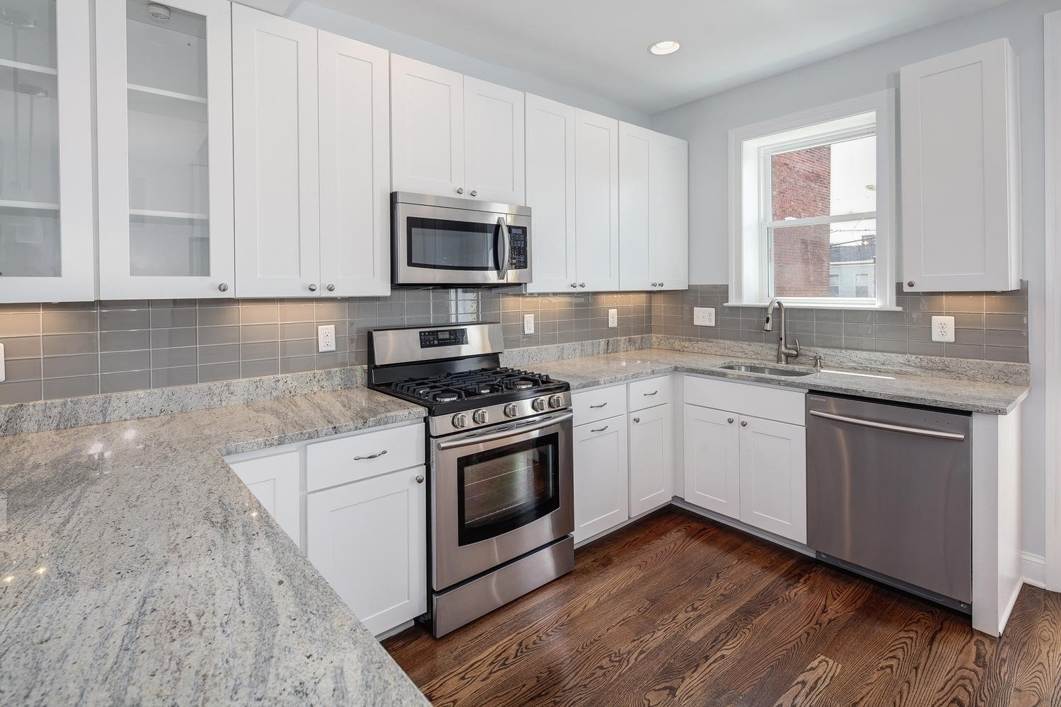 10 Spectacular Kitchen Countertop Ideas With White Cabinets gray granite countertop ideas with white cabinets the best design 2020