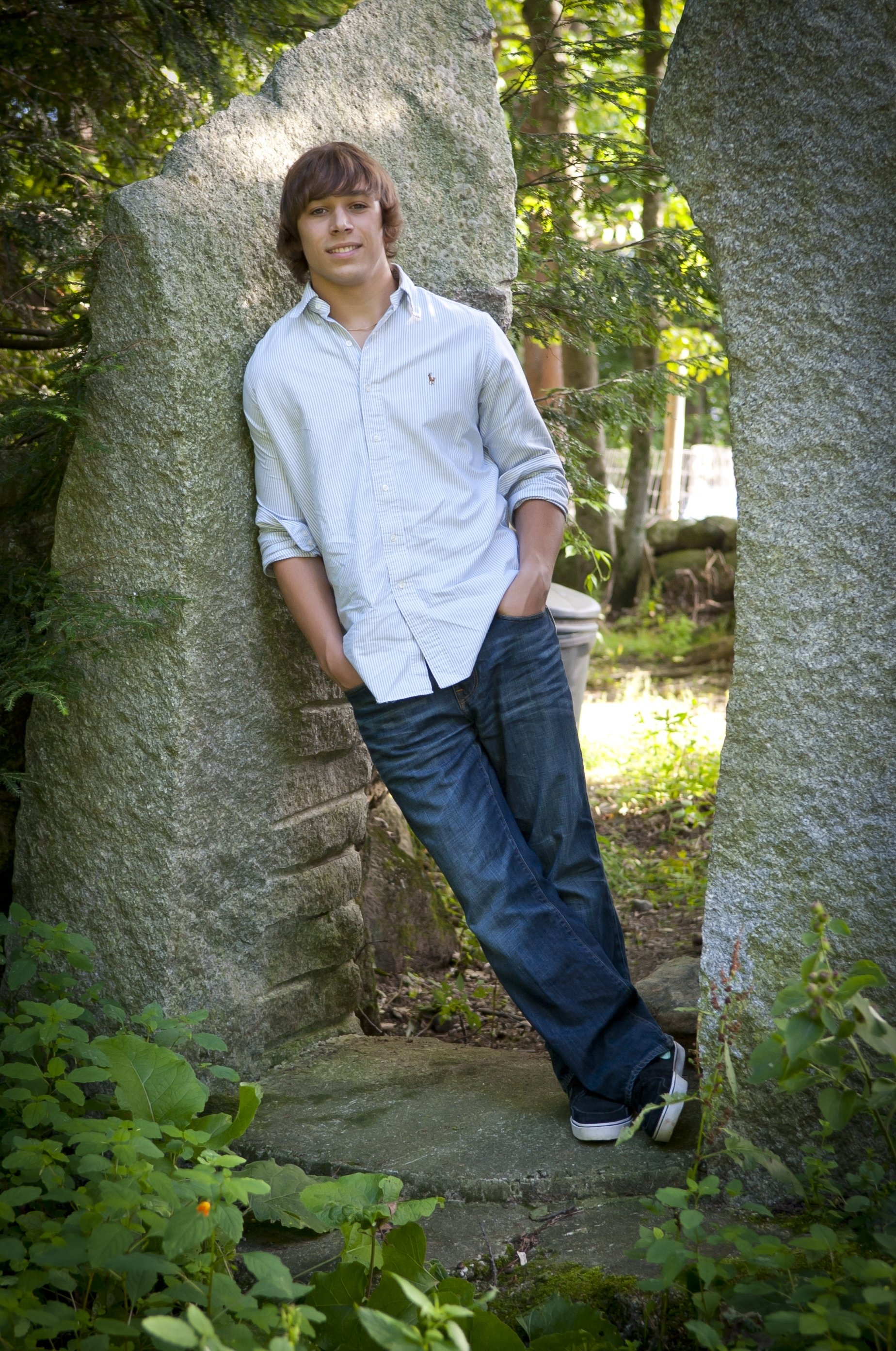 10 Lovable Senior Portrait Ideas For Guys great casual pose between trees or concrete walls for a city look 1 2021