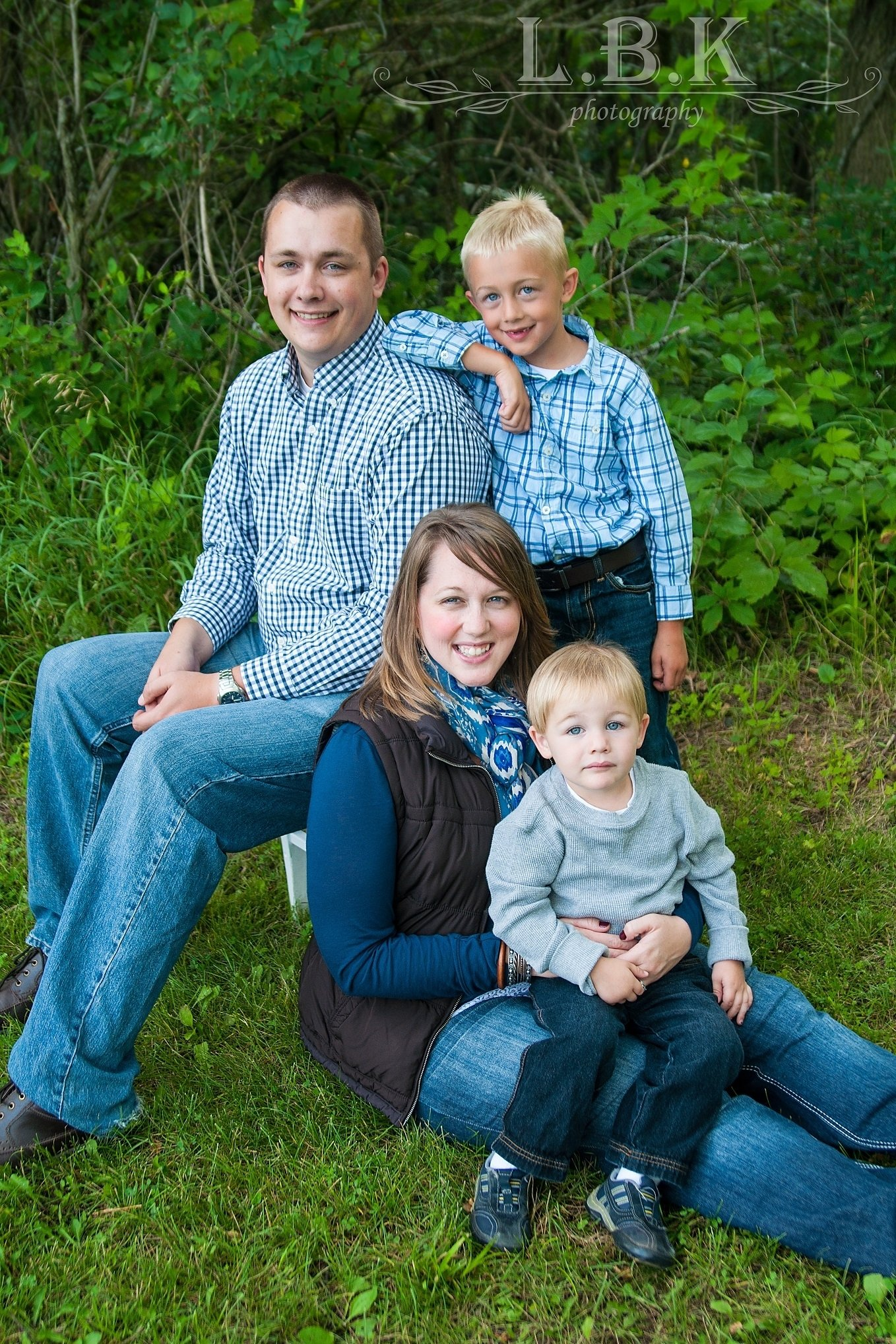 10 Awesome Family Of Four Photo Ideas great family of four pose family photo pose ideas blue and grey 1 2021