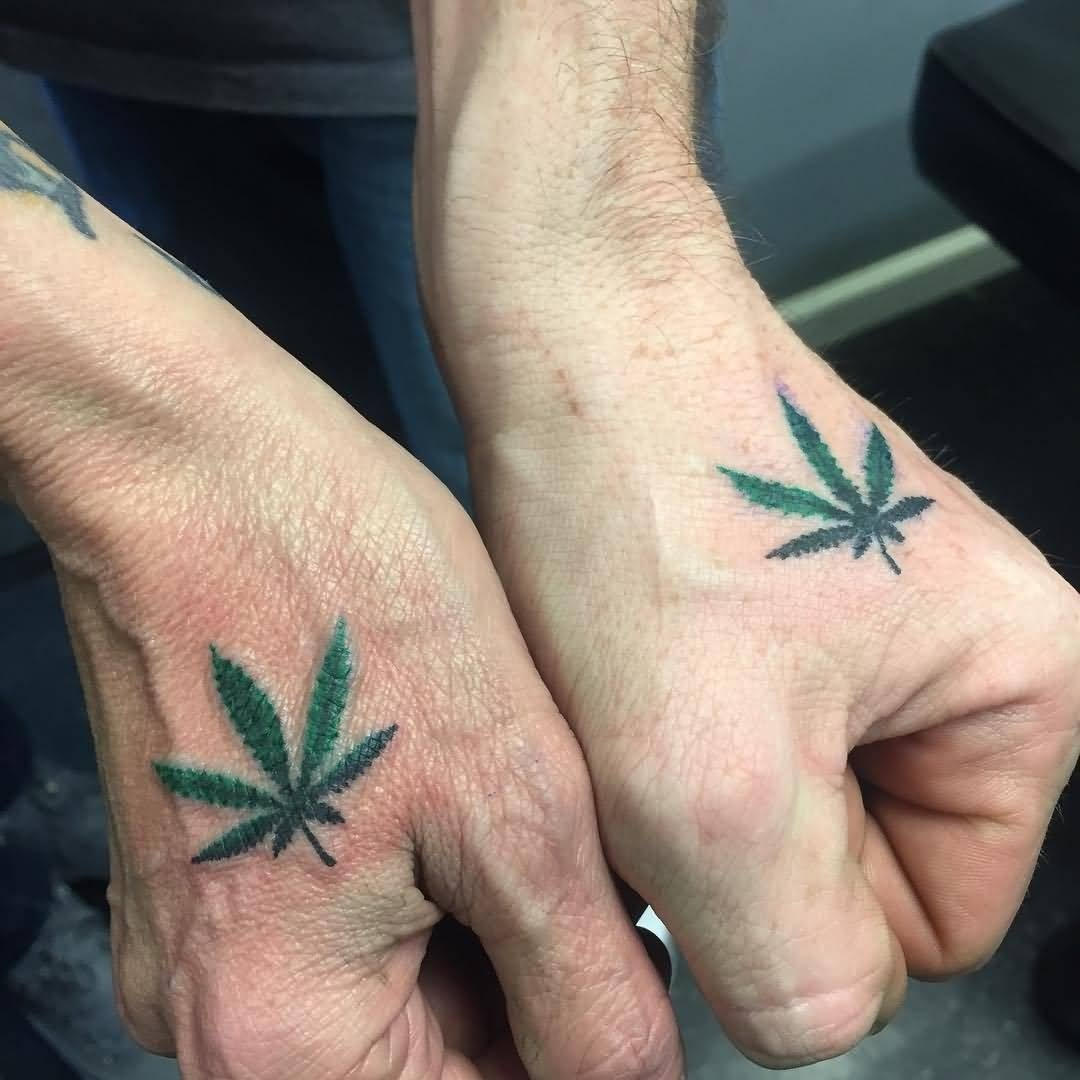 10 Most Popular Matching Tattoo Ideas For Couples green color small leaf matching tattoos on hands