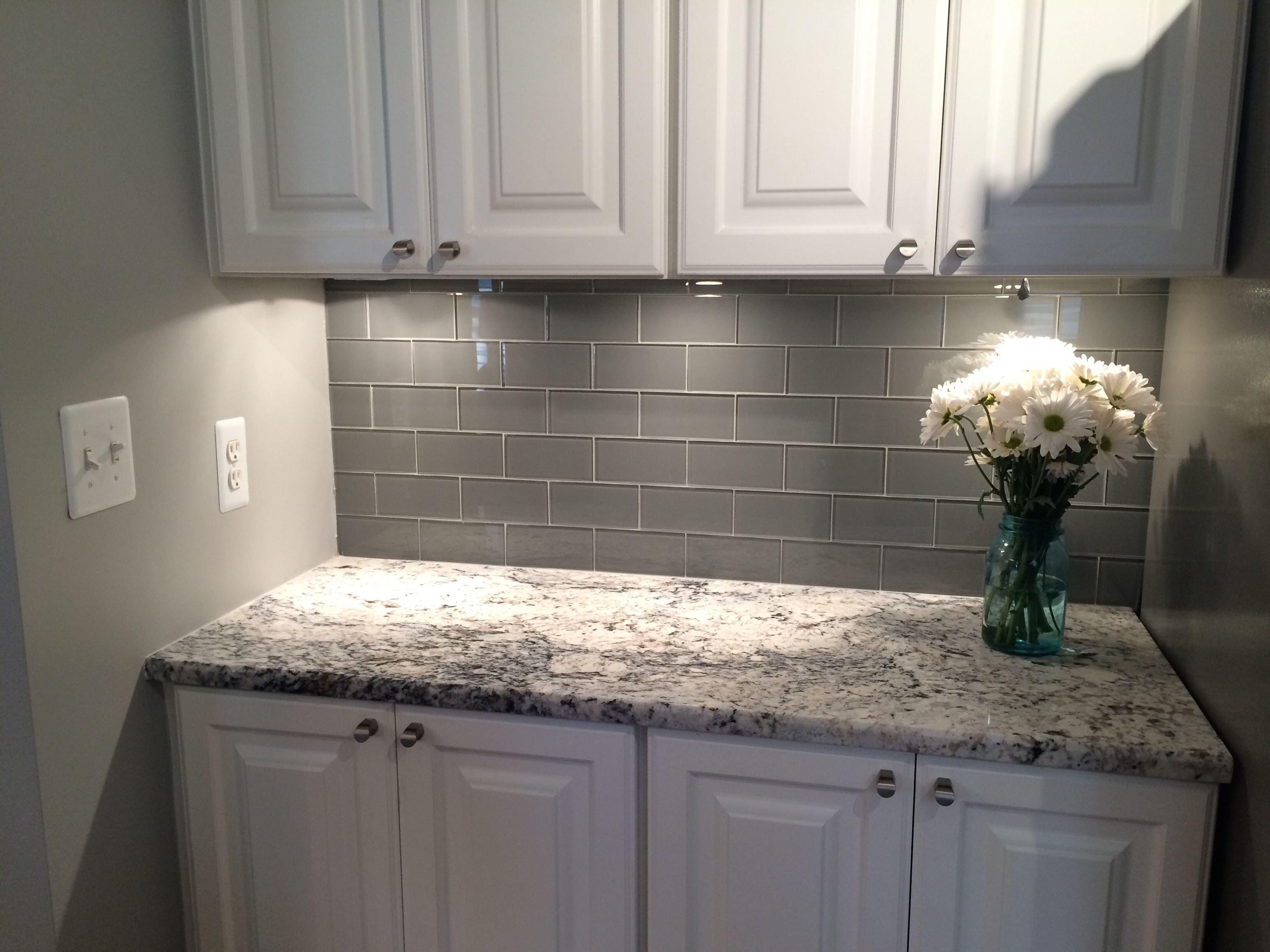 10 Gorgeous Subway Tile Kitchen Backsplash Ideas grey glass subway tile backsplash and white cabinet for small space 1 2020