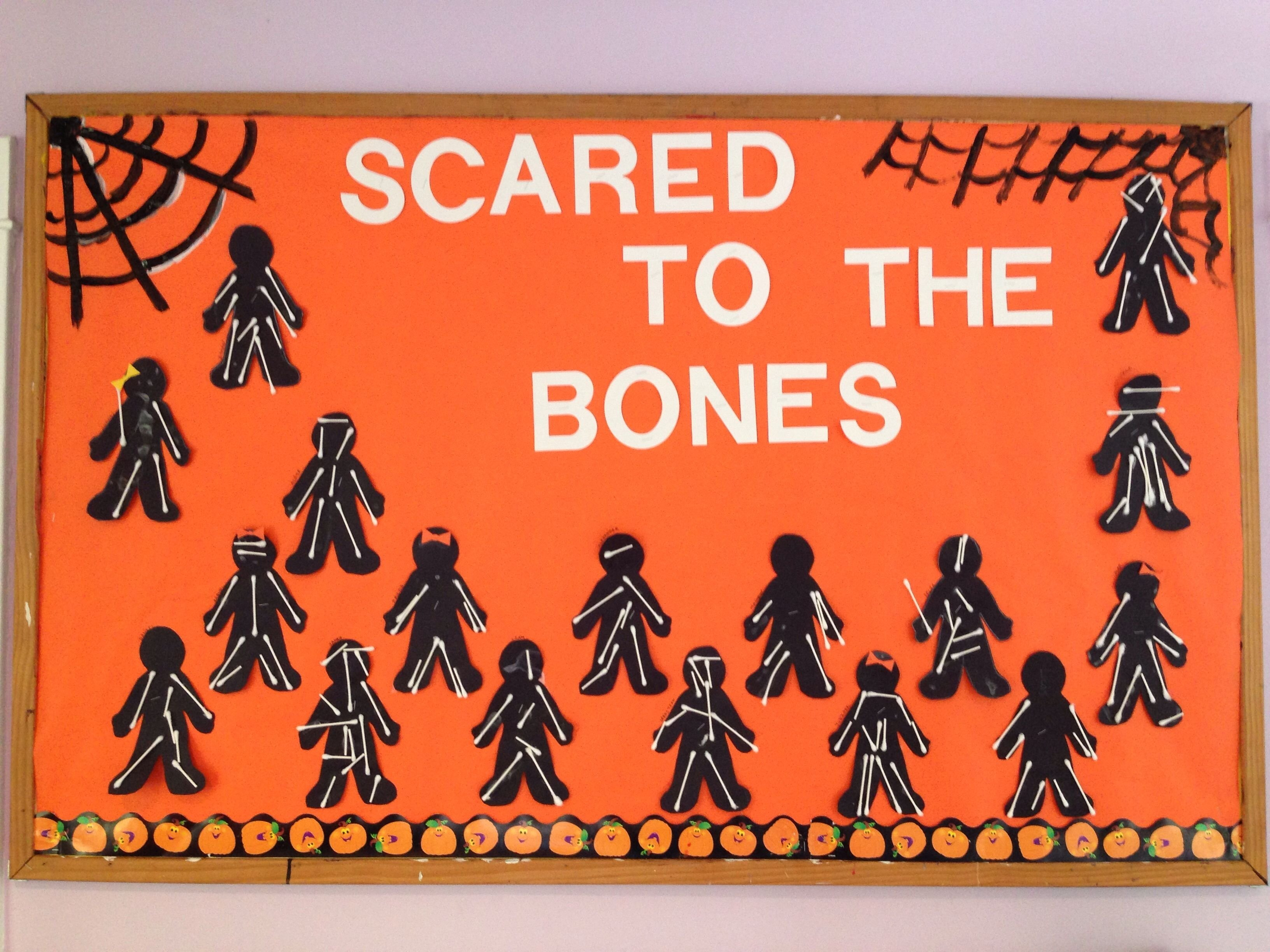 halloween bulletin board idea where students create skeletons