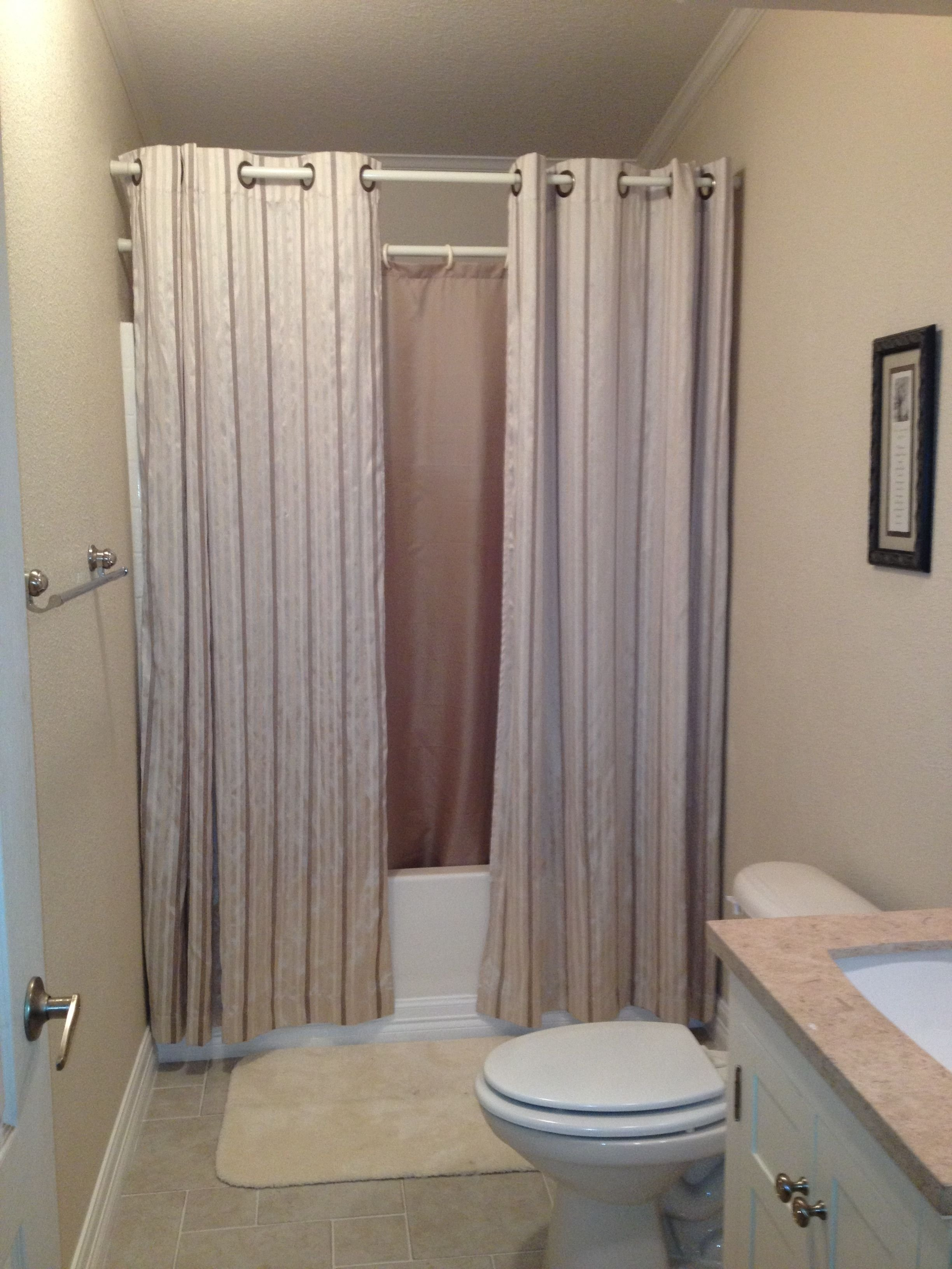 10 Trendy Shower Curtain Ideas For Small Bathrooms hanging shower curtains to make small bathroom look bigger