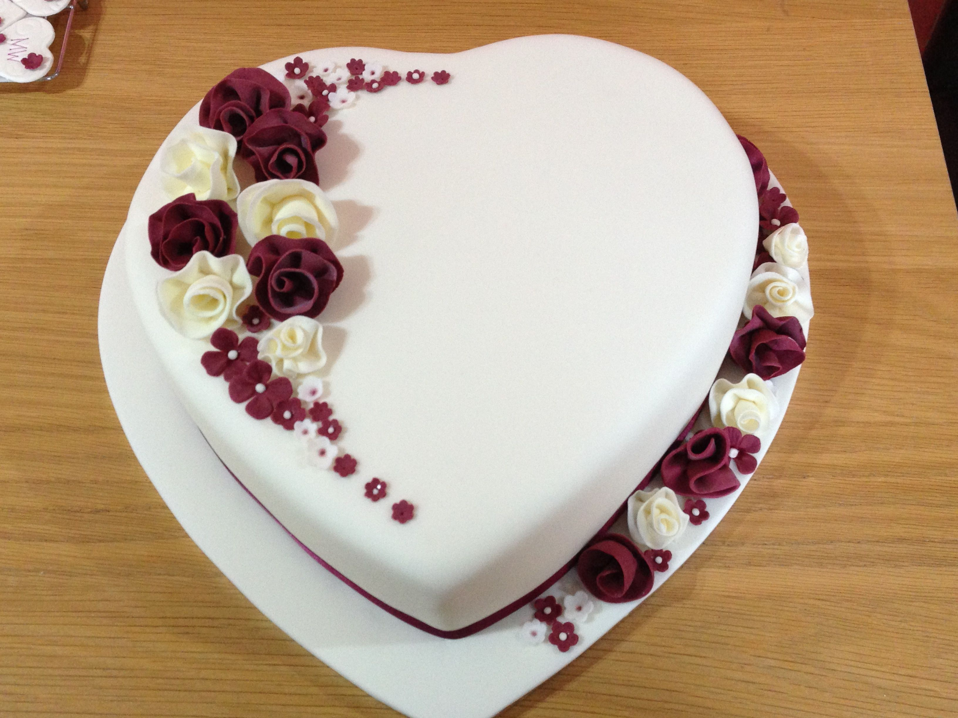 heart shaped wedding cake with whimsical flowers - fondant covered