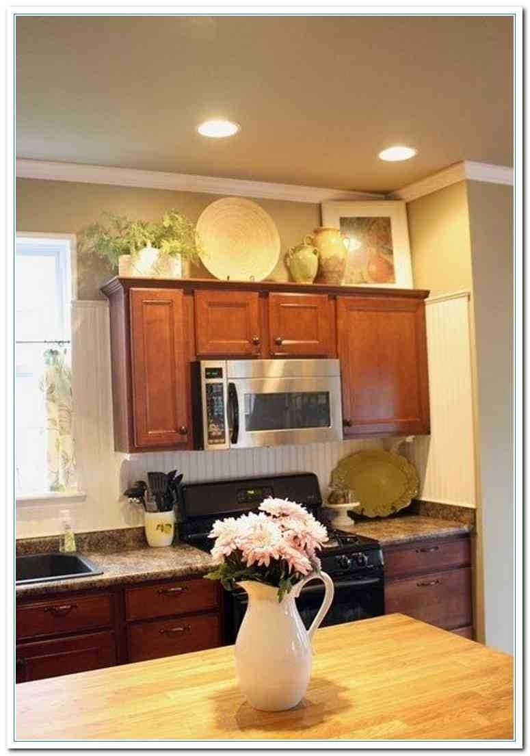 10 Elegant Kitchen Decorating Ideas Above Cabinets home decor above cabinet decorating ideas bronze kitchen wall 1 2020