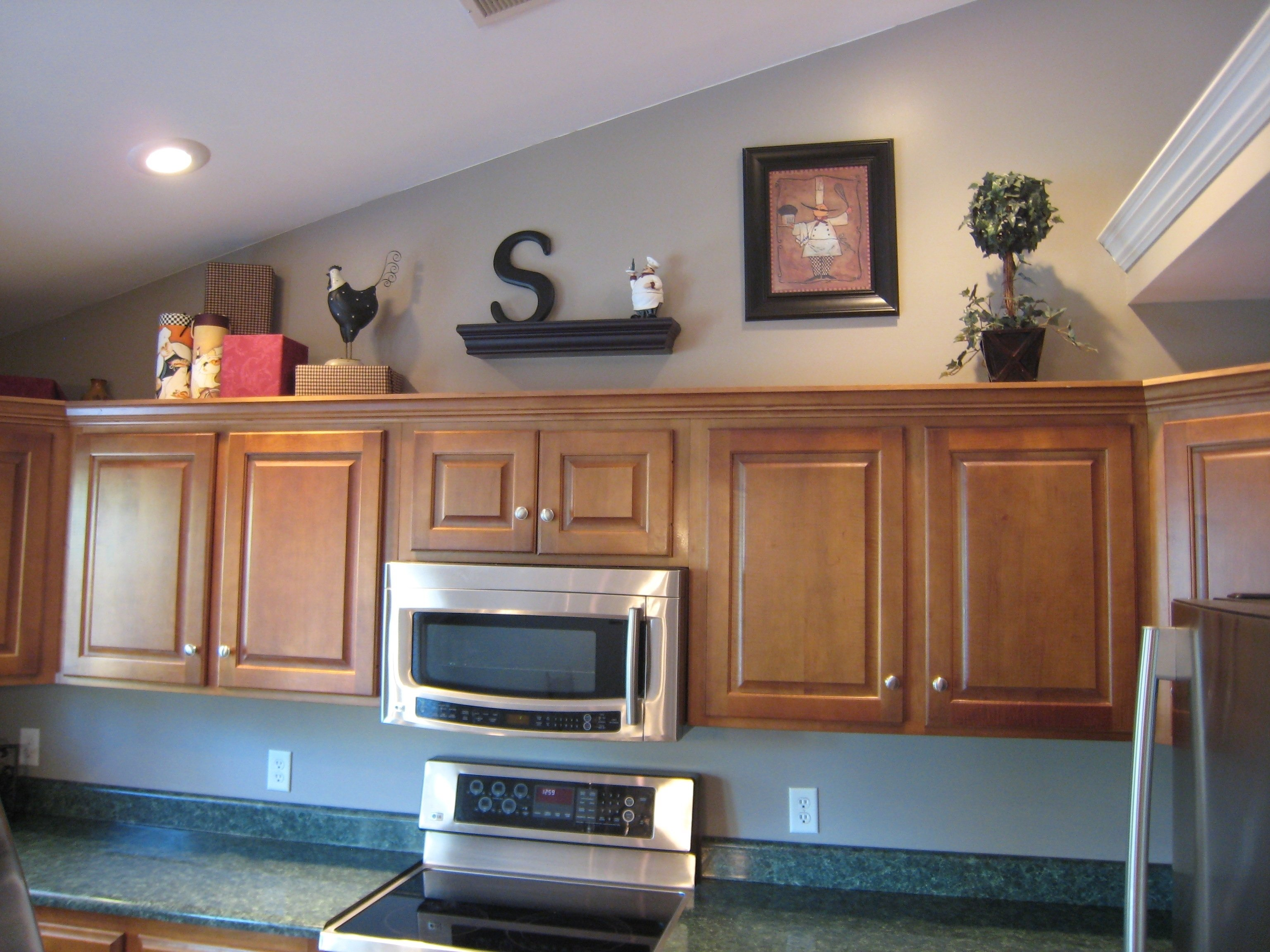 10 Lovely Decorating Ideas For Above Kitchen Cabinets home decor above cabinet decorating ideas bronze kitchen wall 2021
