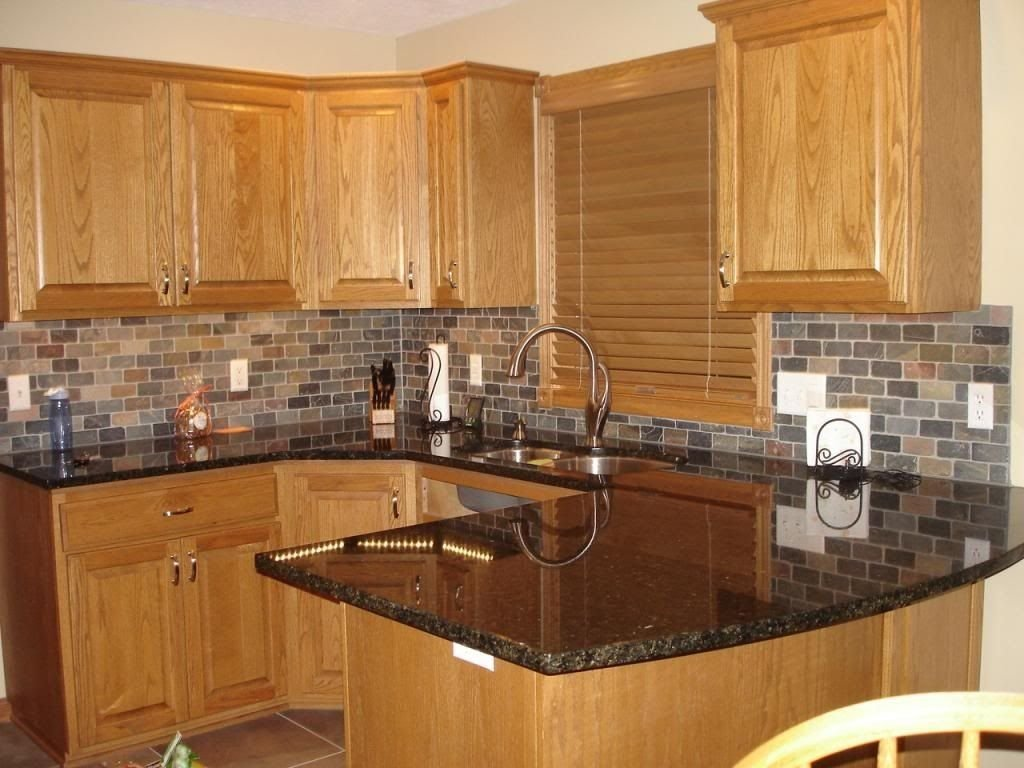10 Best Kitchen Ideas With Oak Cabinets honey oak kitchen cabinets with black countertops pearl or 2020