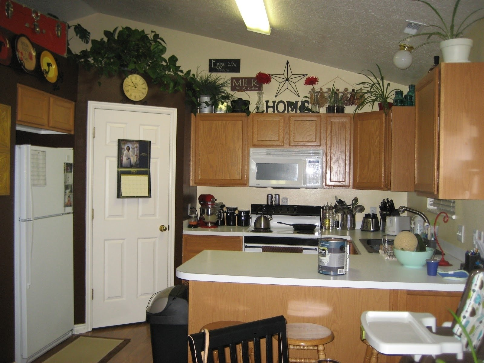 10 Trendy Ideas For Decorating Above Kitchen Cabinets ideas for decorating above kitchen cabinets elegant decorating 2020