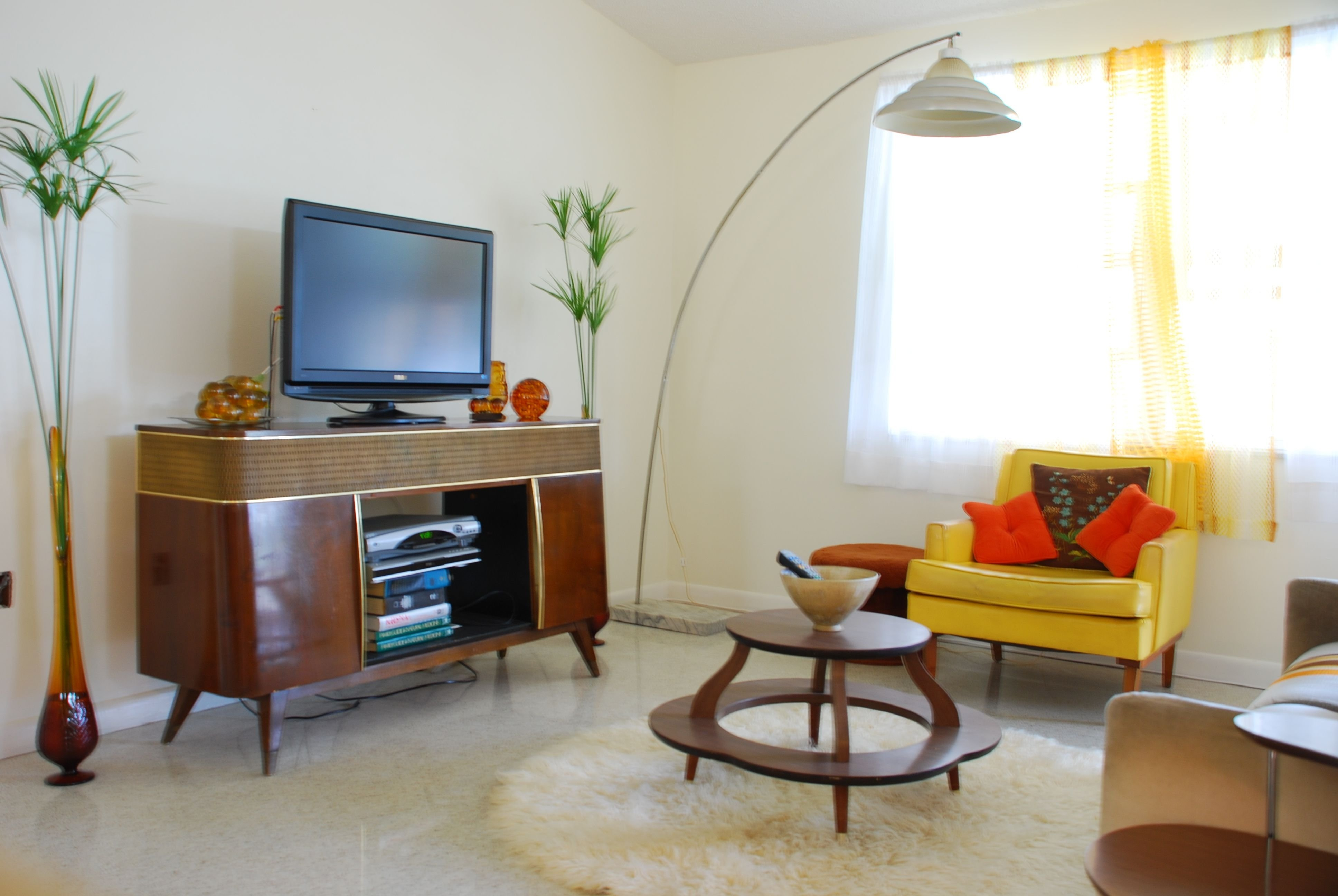10 Unique Mid Century Modern Decorating Ideas impressive hanging ball chair applied mid century modern living room 2020
