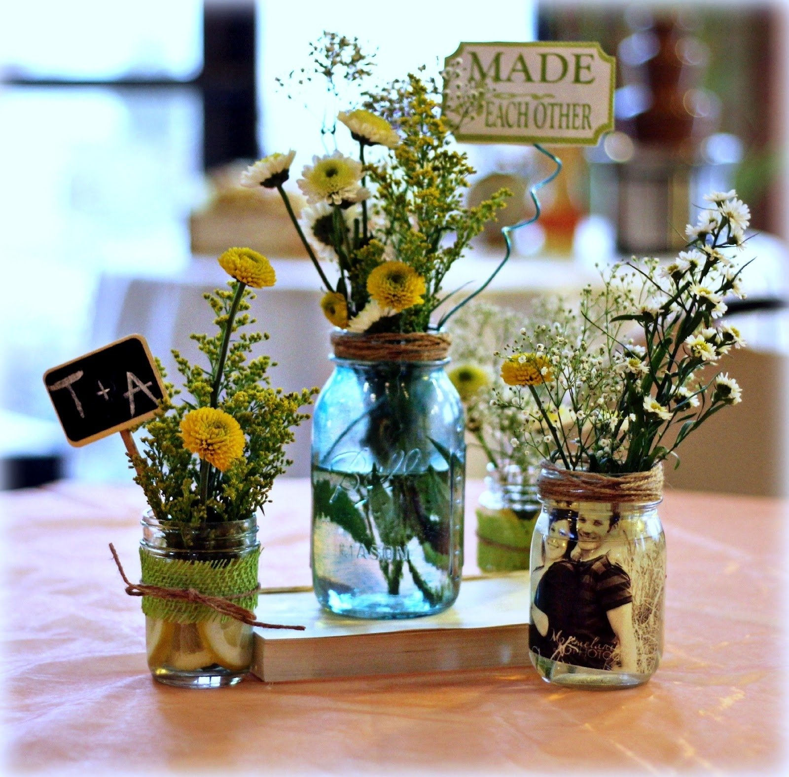 10 Stylish Mason Jar Wedding Centerpiece Ideas in case the mason jars with lights in them are used elsewhere in the 2020