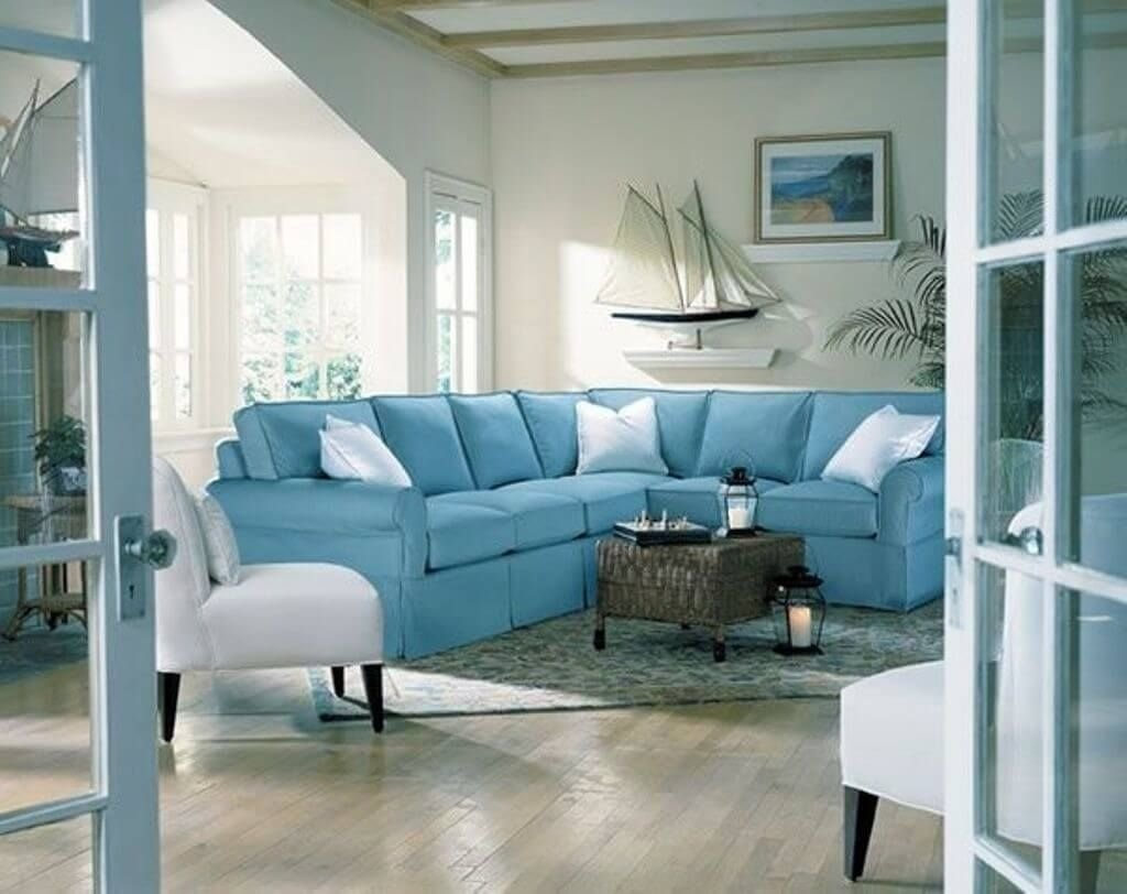 10 Fashionable Beach Themed Living Room Ideas interior design calming blue and white beach themed living room 2021