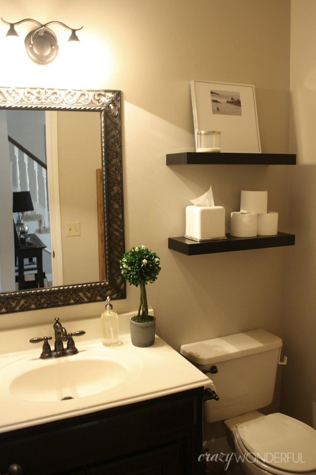 10 Ideal Small Powder Room Decorating Ideas interior unique brown wooden cabinet white ceramic toilet small 2020