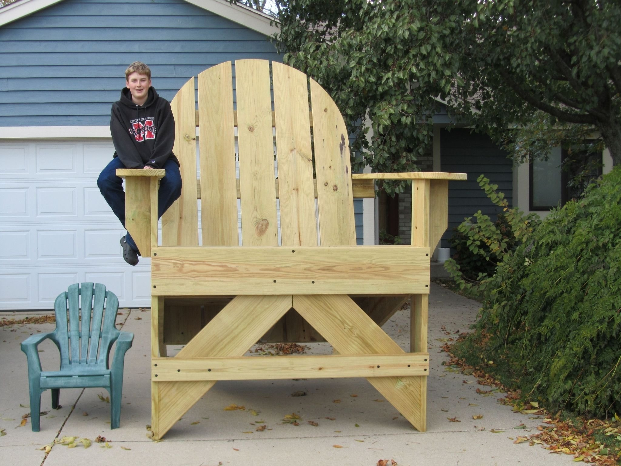 10 Cute Eagle Scout Service Project Ideas jarod sharp of muskego sits on the arm of a huge adirondack chair he 2021