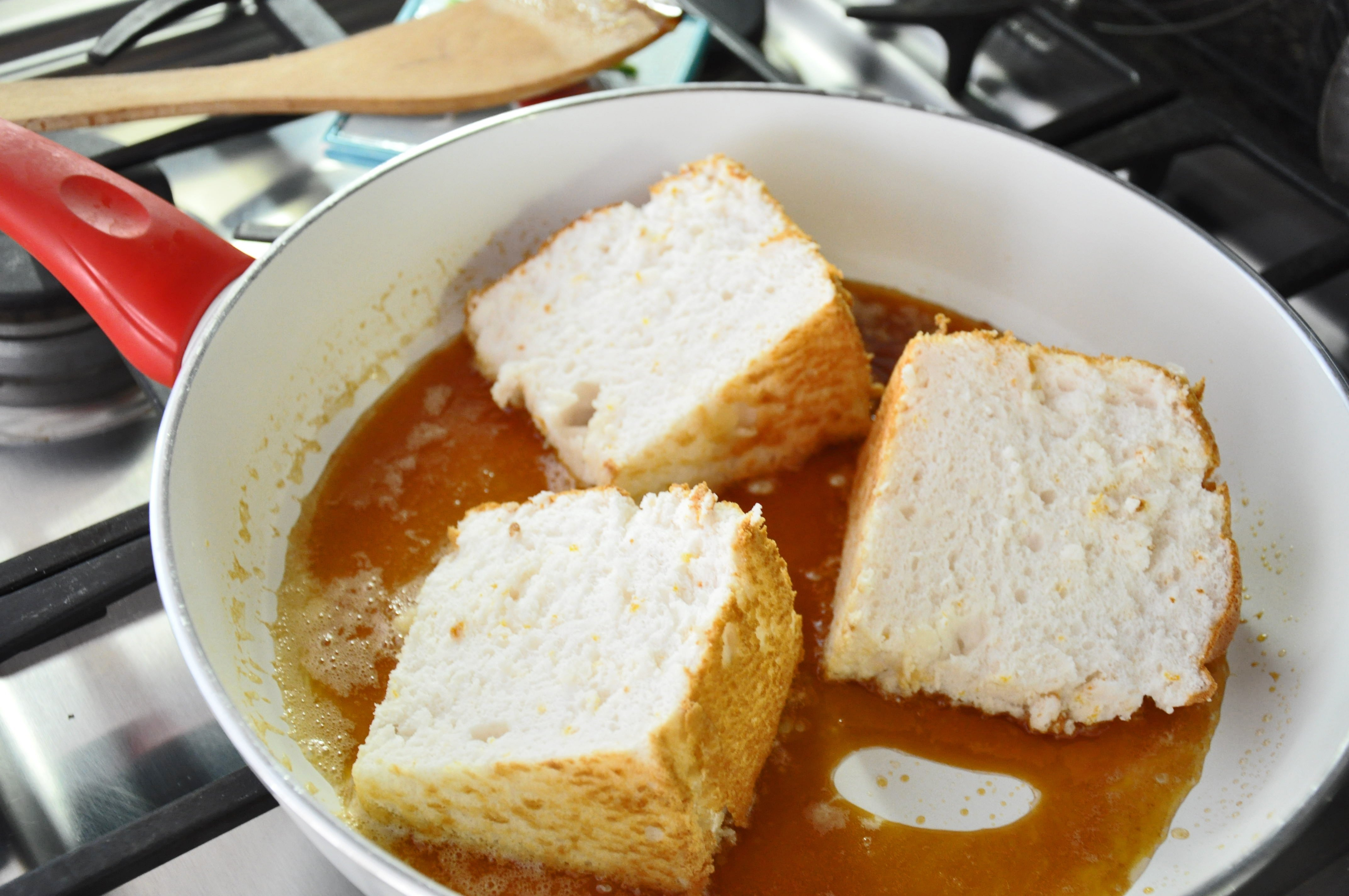 10 Famous Angel Food Cake Recipe Ideas lacquered angel food cake sifting focus 2020