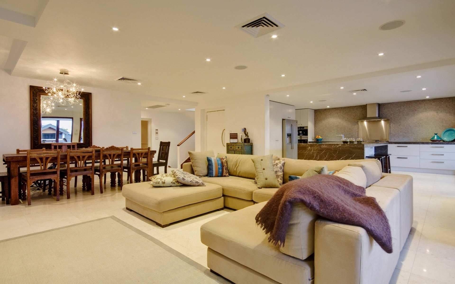 10 Elegant Large Living Room Design Ideas large living room multi family house interior design decobizz 2021