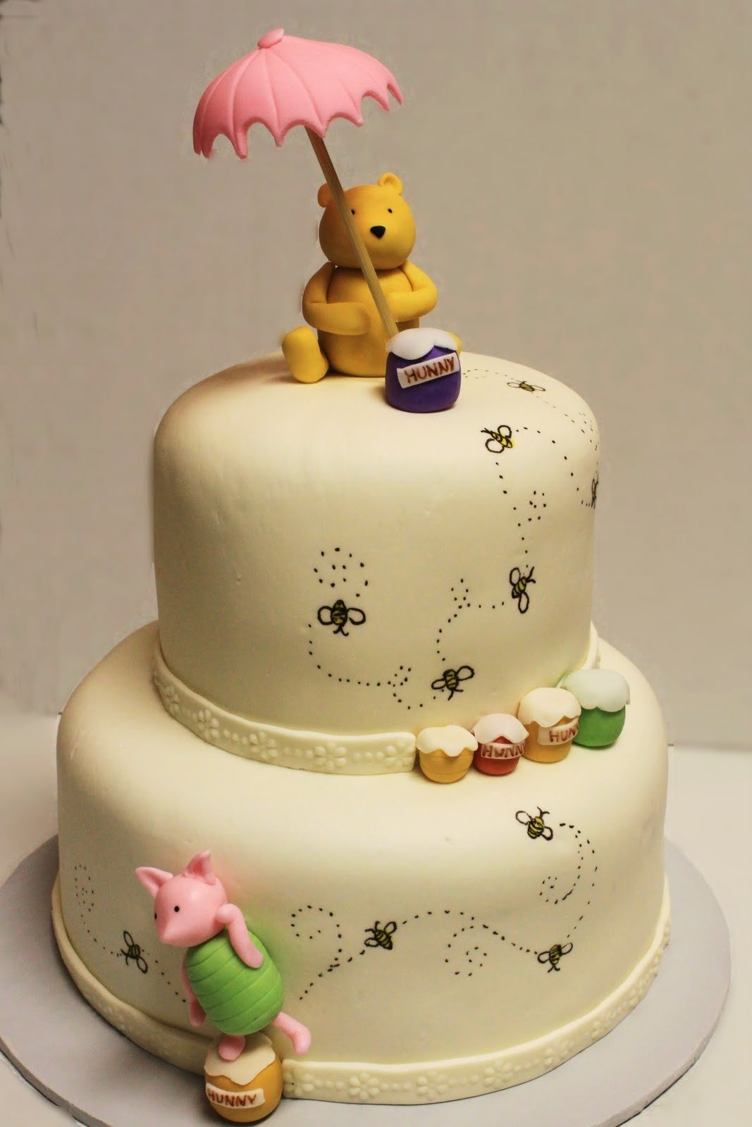 10 Fantastic Winnie The Pooh Cake Ideas layers of love winnie the pooh shower cake 2021