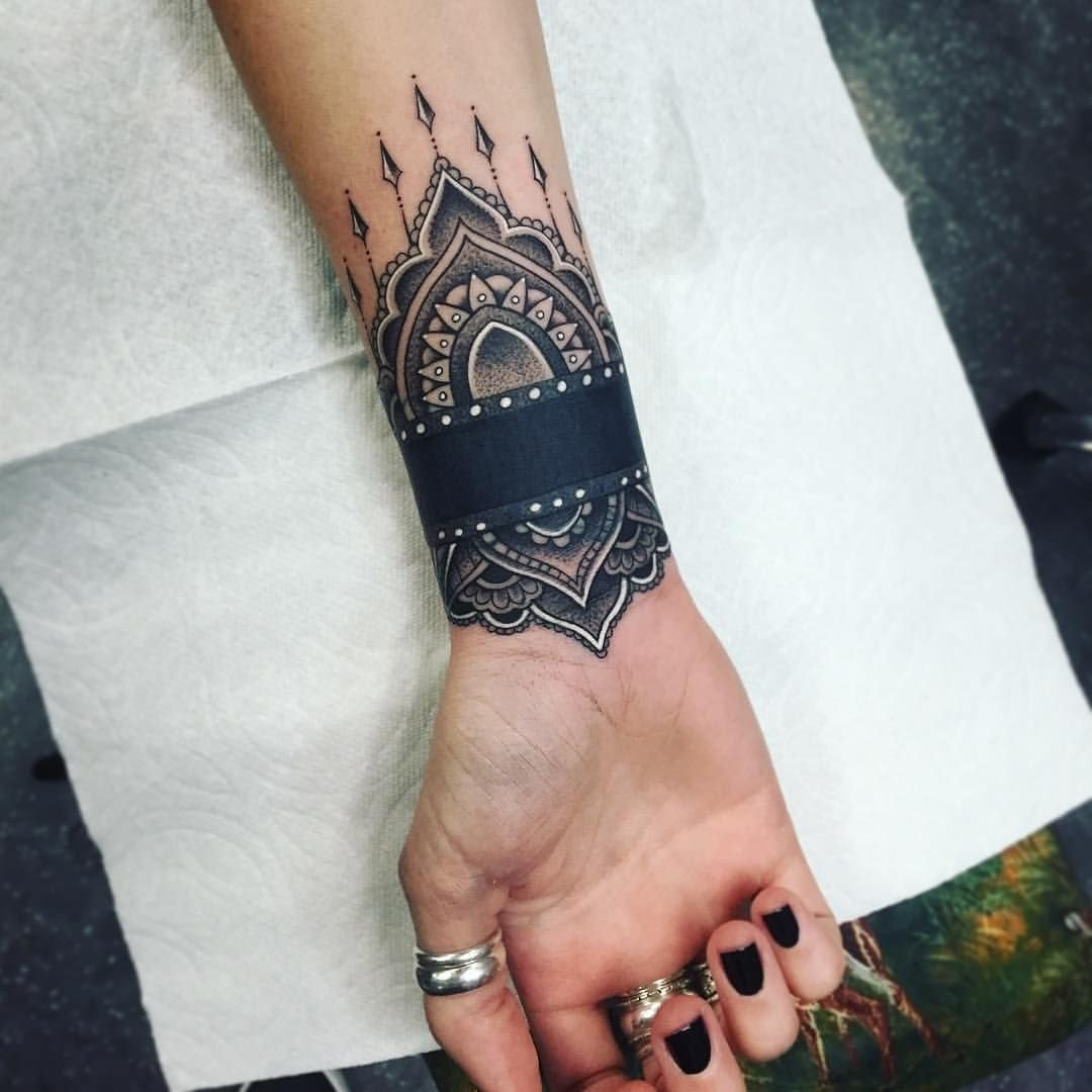 10 Beautiful Wrist Tattoo Cover Up Ideas less black on me but i like how the cuff is detailed rather that a 1 2020