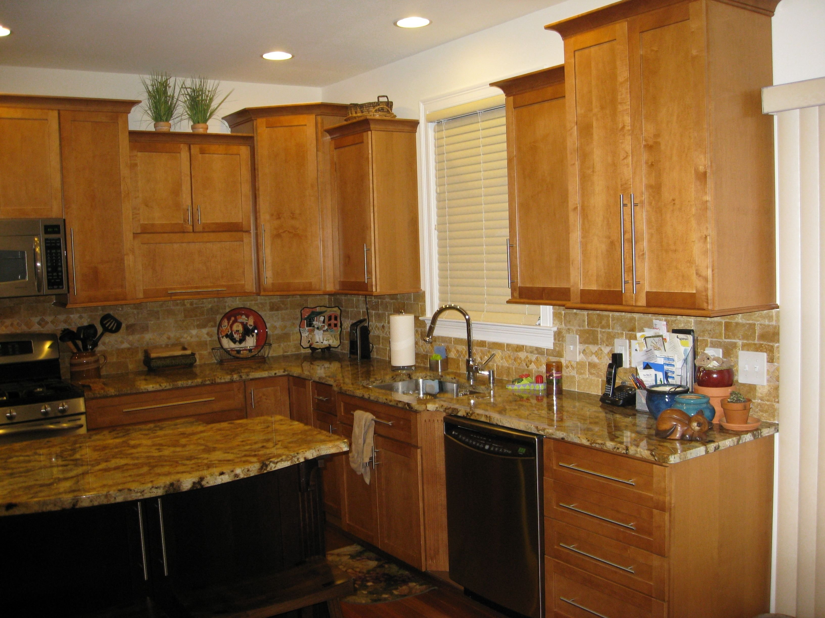 10 Amazing New Venetian Gold Granite Backsplash Ideas light maple cabinets with new venetian gold granite google search 2021