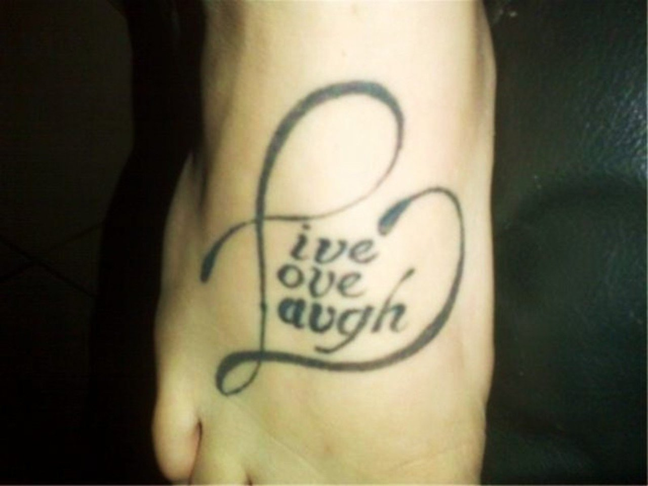 live laugh love tattoo on right foot