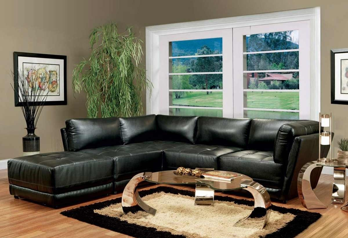 10 Fashionable Black Couch Living Room Ideas living room dark sofa in living room with tan area rug ideas black