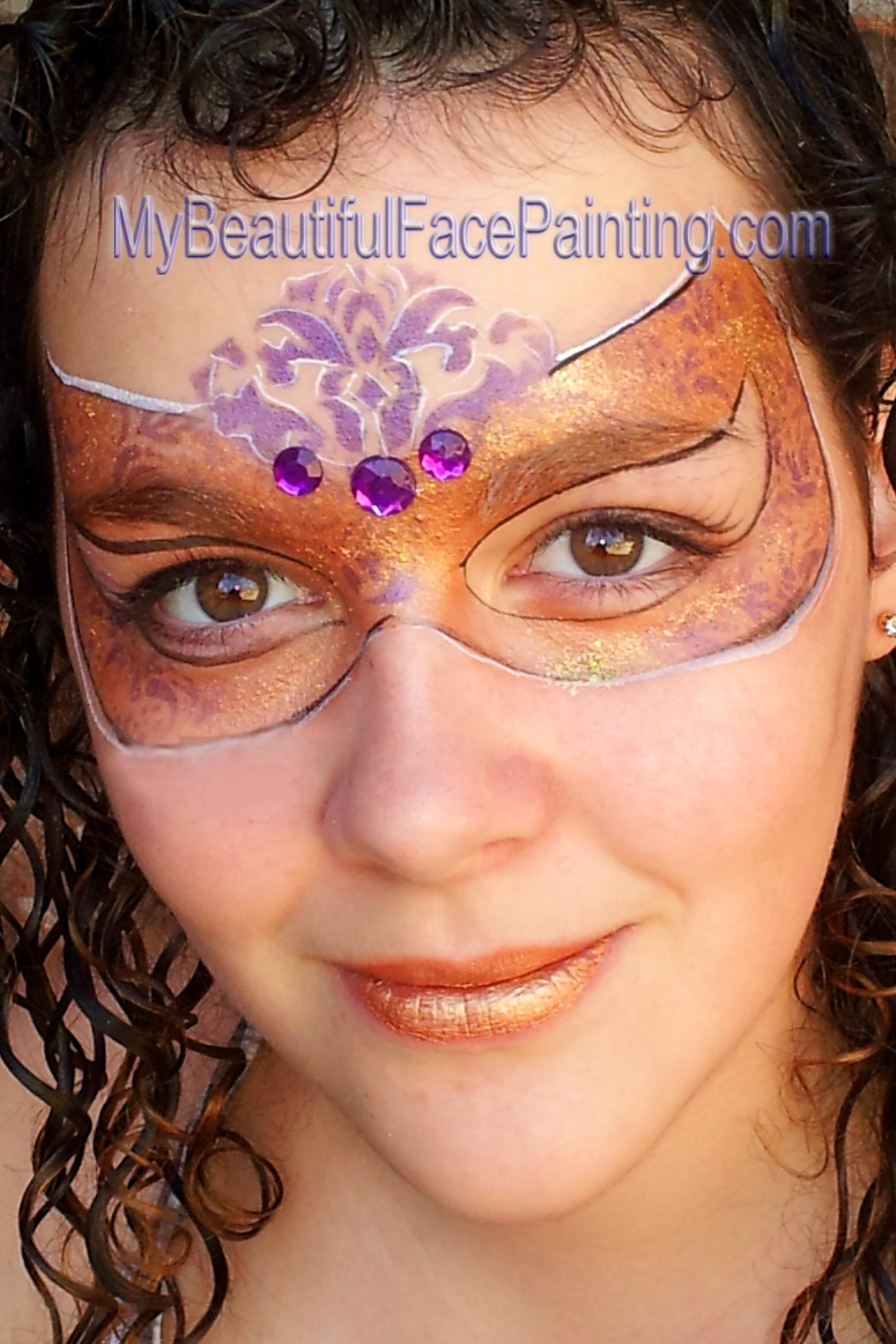 10 Wonderful Mardi Gras Face Painting Ideas mardi gras face painting mask in gold and purple face and body 2020