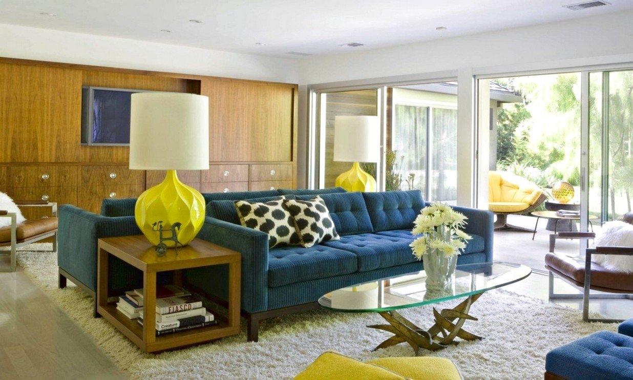 10 Amazing Mid Century Modern Living Room Ideas mid century modern living room ideas with blue sofa and round table 2021