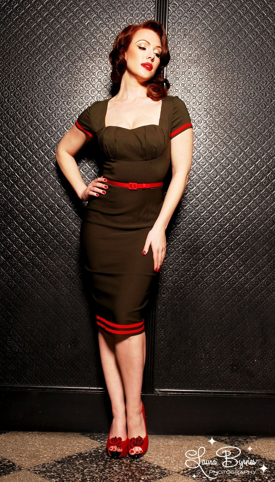 military pinup dress in olive green with red details from pinup