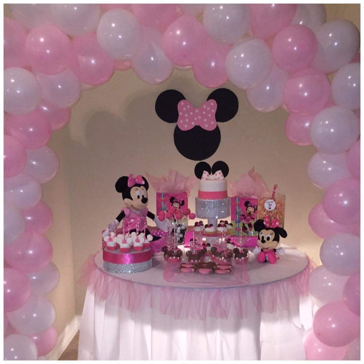 10 Perfect Baby Minnie Mouse Birthday Party Ideas minnie mouse party table and pink and white balloon archthe 1