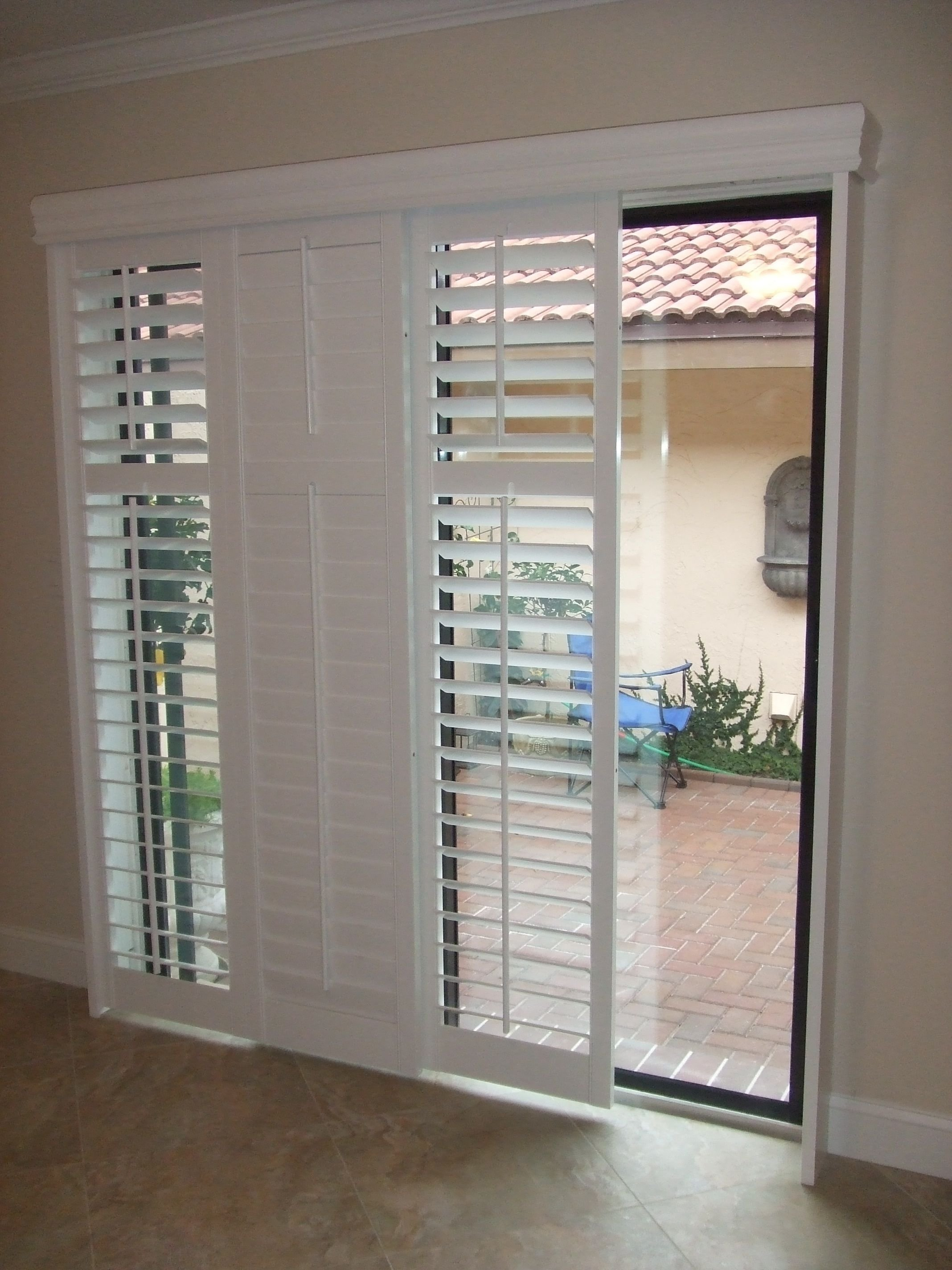 10 Beautiful Ideas For Sliding Glass Doors modernize your sliding glass door with sliding plantation shutters 1 2020