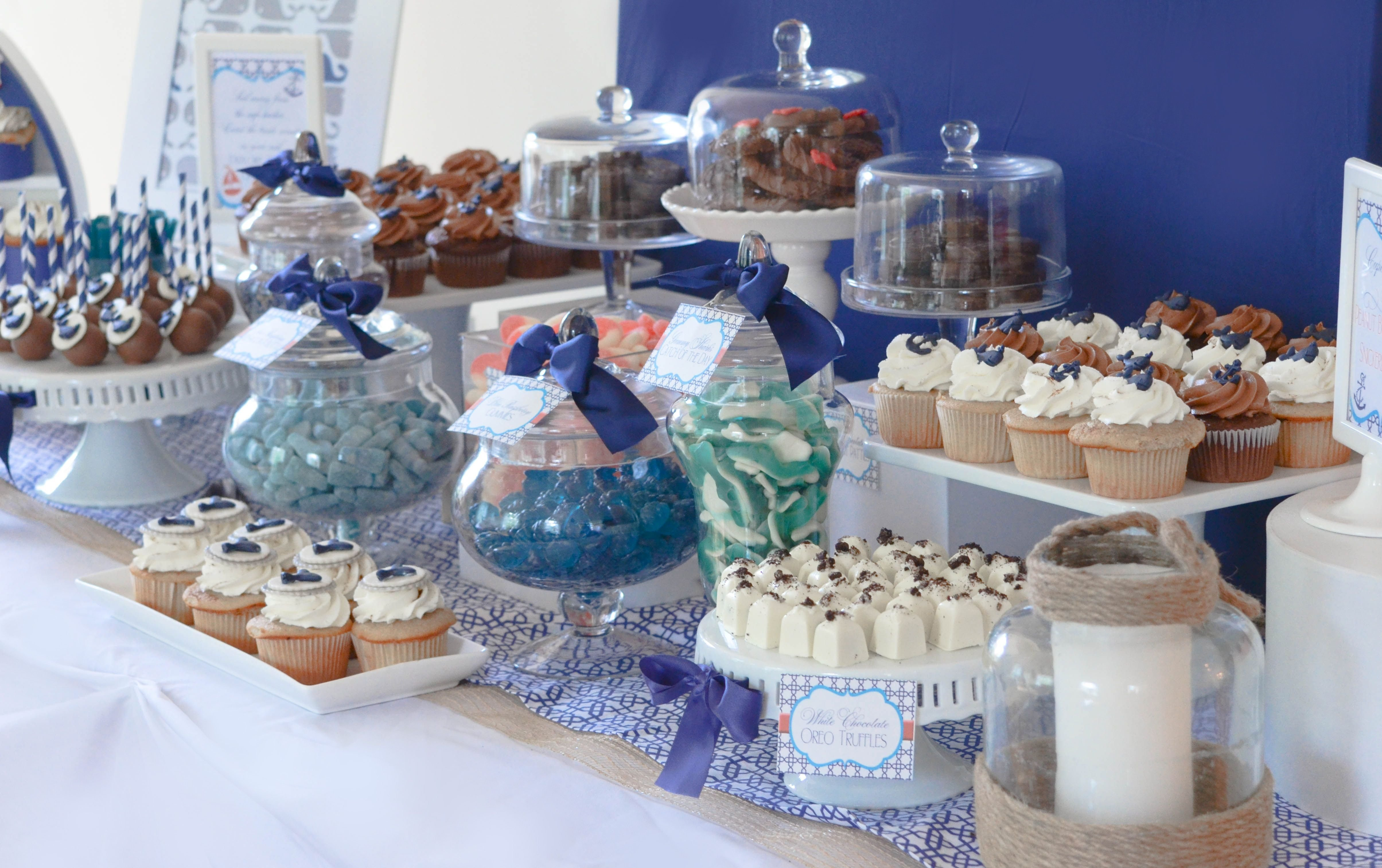 10 Pretty Candy Table Ideas For Baby Shower navy and white nautical candy and dessert table quatrefoil whales