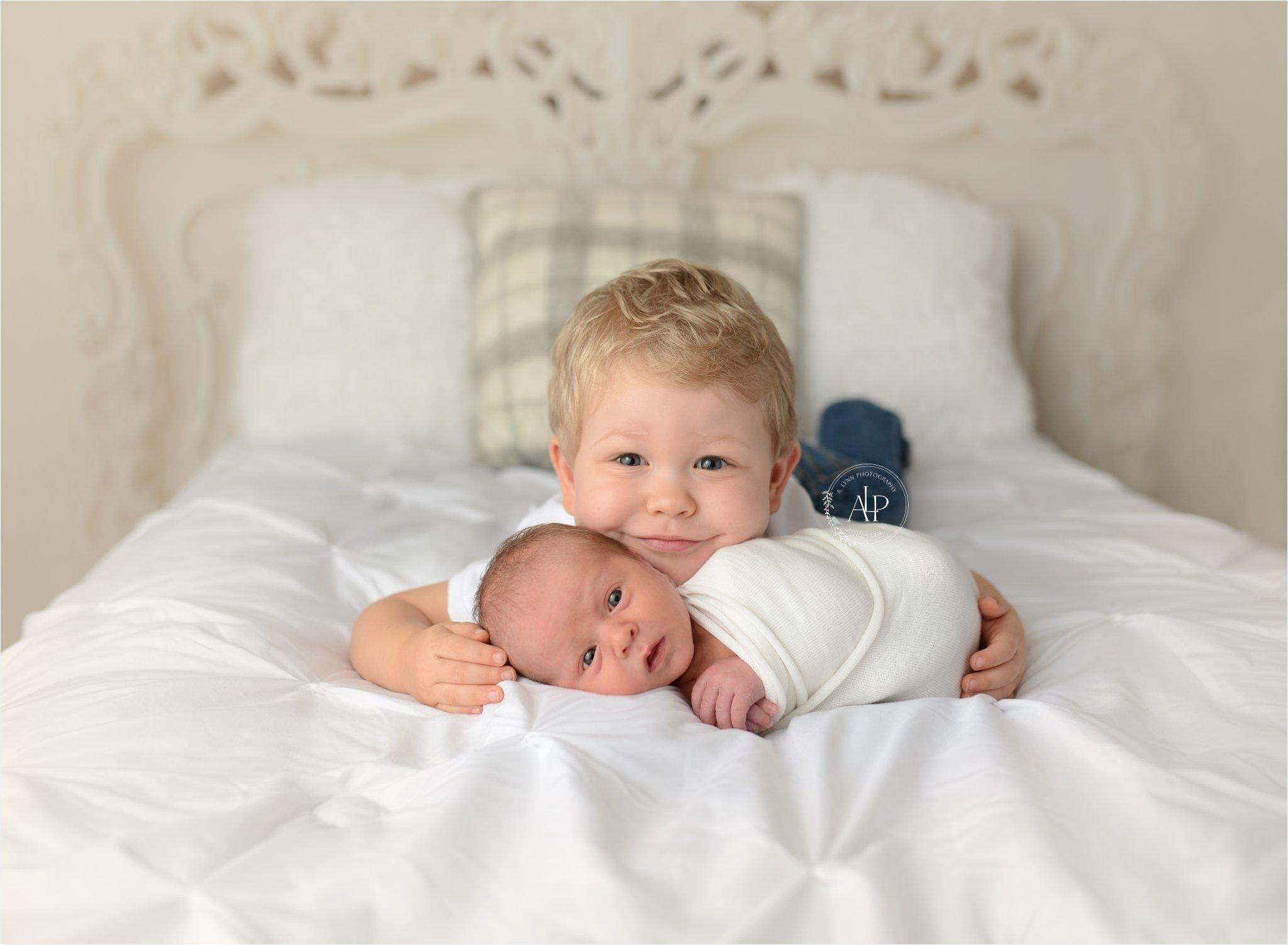 10 Stylish Newborn Photo Ideas With Siblings newborn with sibling brothers newborn poses newborn posesa