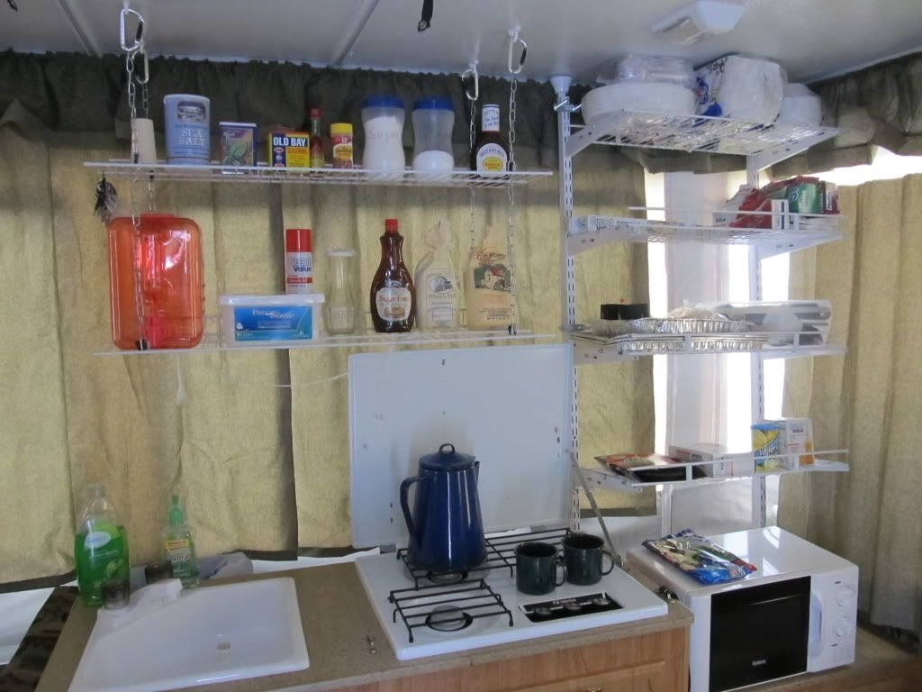 10 Lovable Pop Up Camper Storage Ideas organizing tips for pop ups this is intense we dont cook inside