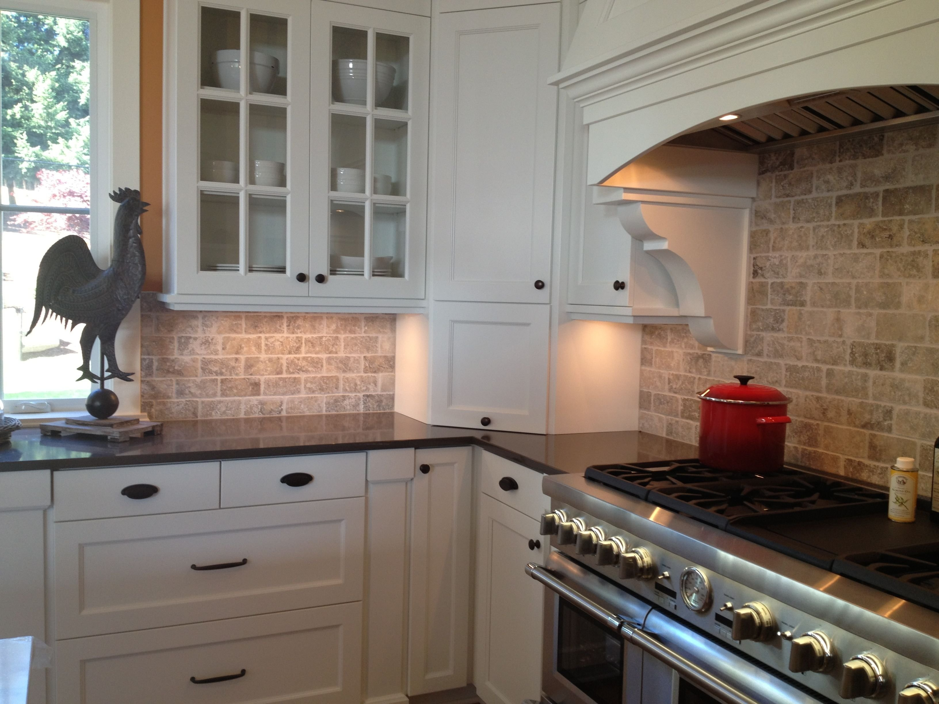 picture of kitchen travertine backsplash with white cabinets and