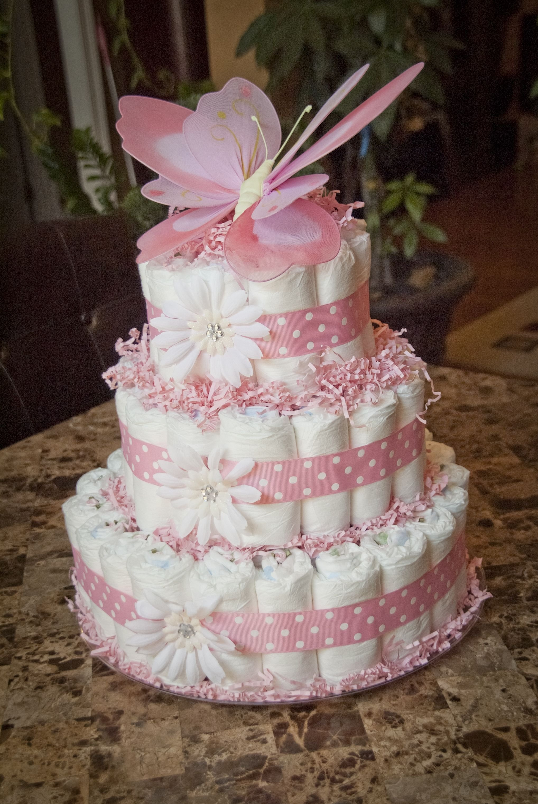pink baby girl shower diaper cake topped with butterfly | things i