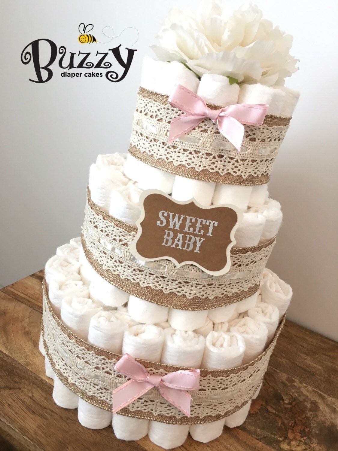 10 Awesome Diaper Cake Ideas For A Girl pinkay stem on diaper cake pinterest shower centerpieces 2020