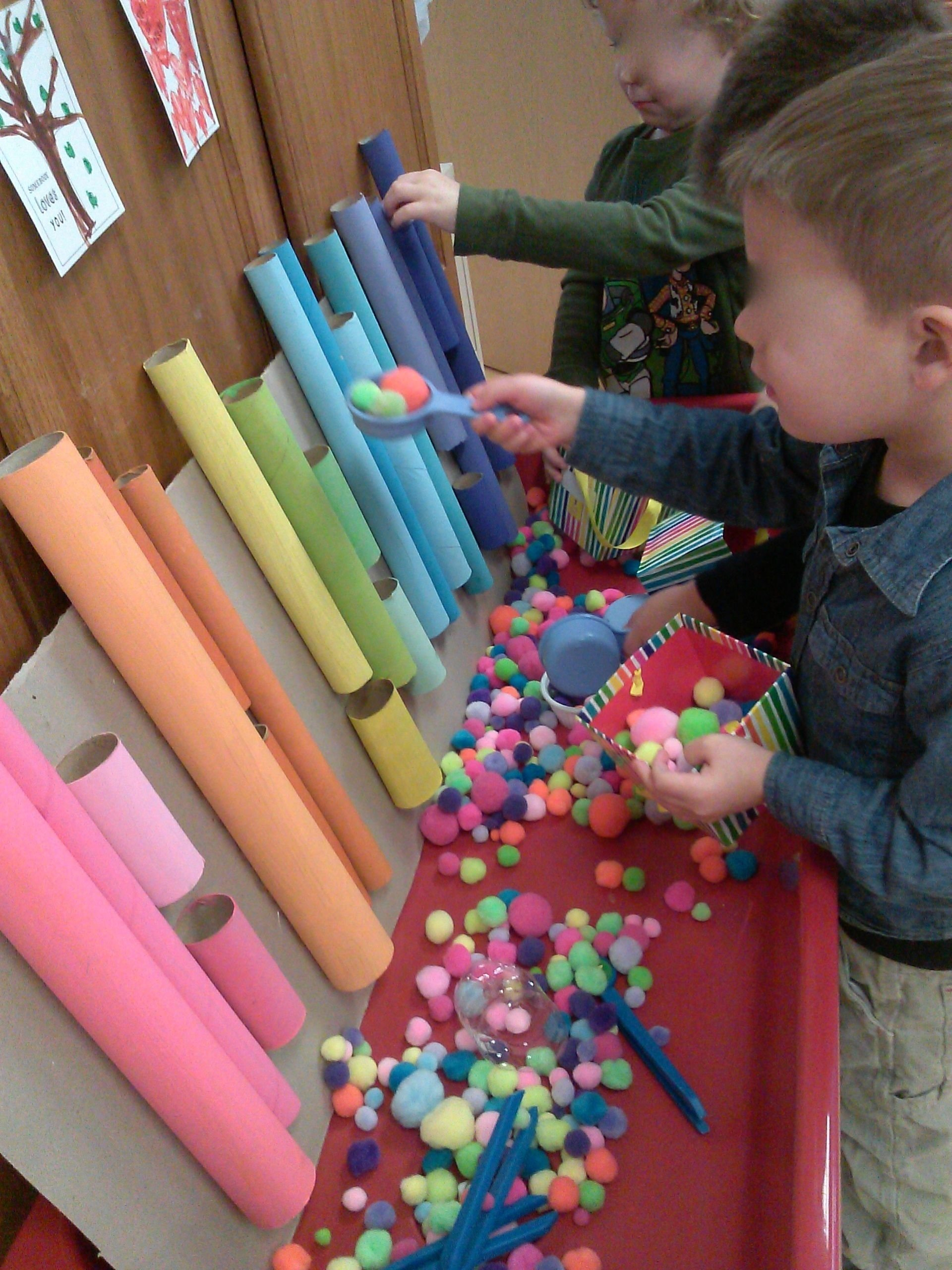 10 Nice Sensory Table Ideas For Toddlers pom pom sorting using tongs and scoops sensory table sensory