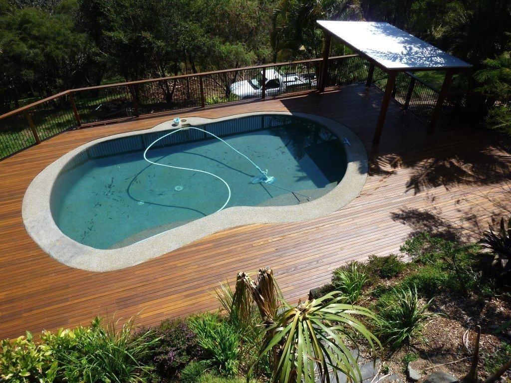 10 Elegant Pool Deck Ideas For Inground Pools pool decking brisbane timber pool deck builders deking 2021