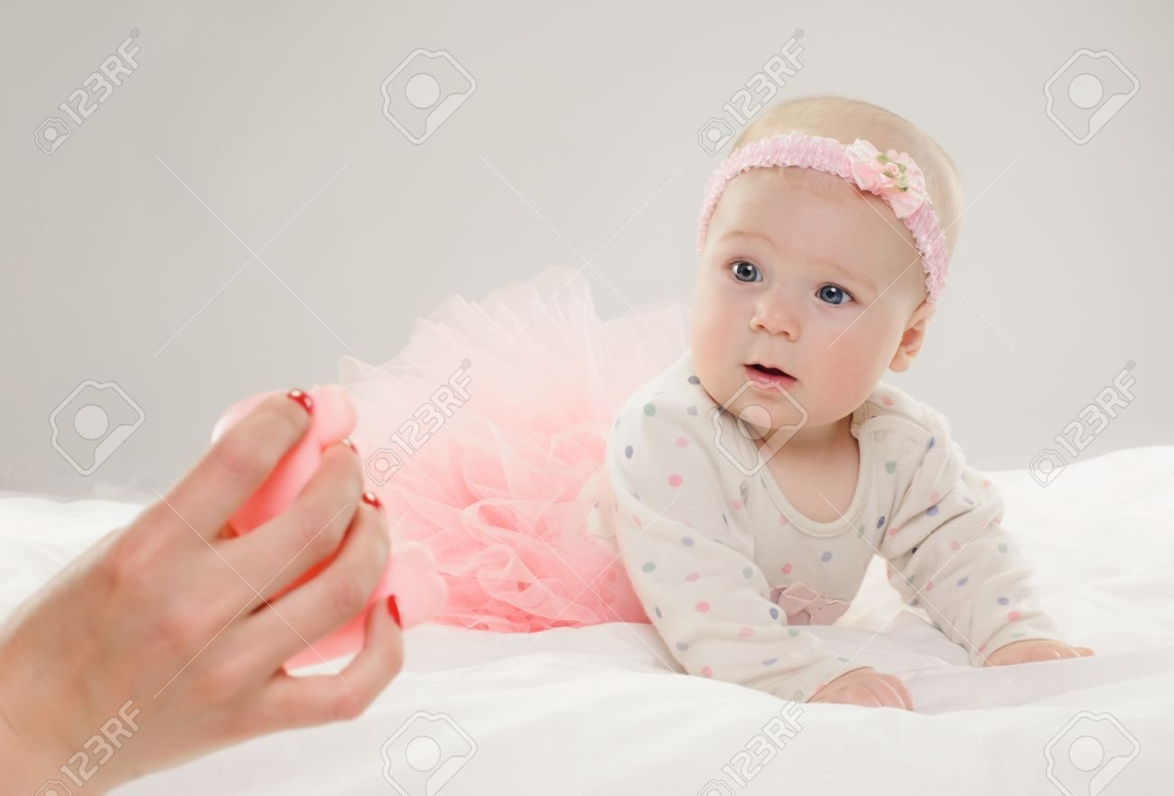 10 Nice 6 Month Baby Girl Picture Ideas portrait of six month old baby girl in pink dress on grey 2021