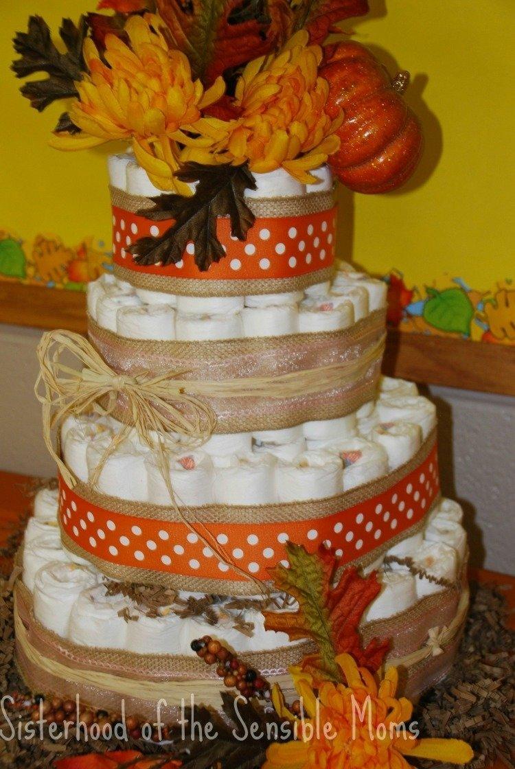 10 Gorgeous Fall Themed Baby Shower Ideas pumpkin all the baby things fall baby shower ideas fall diaper cake 2020