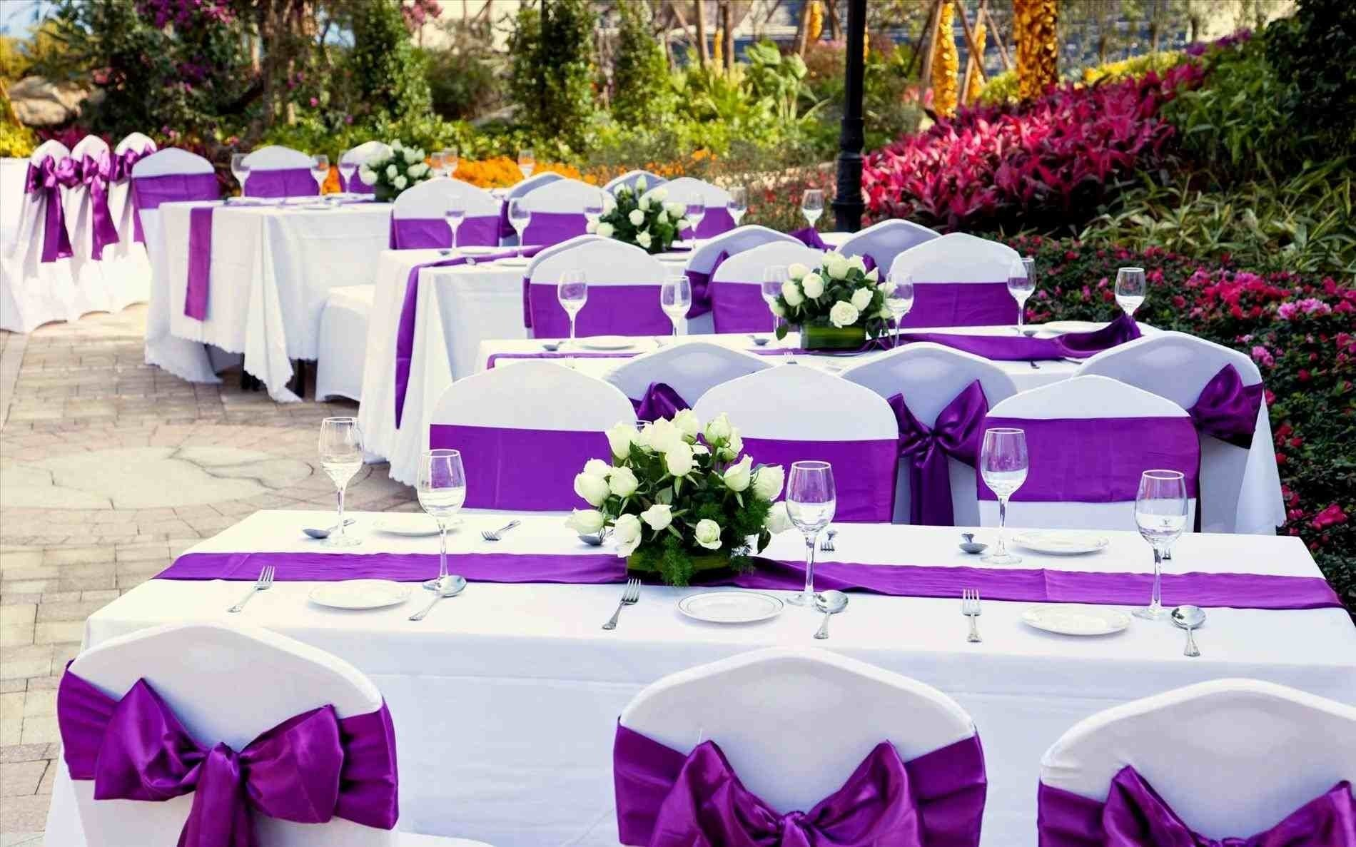 purple and white wedding ideas table with four level tray for cup