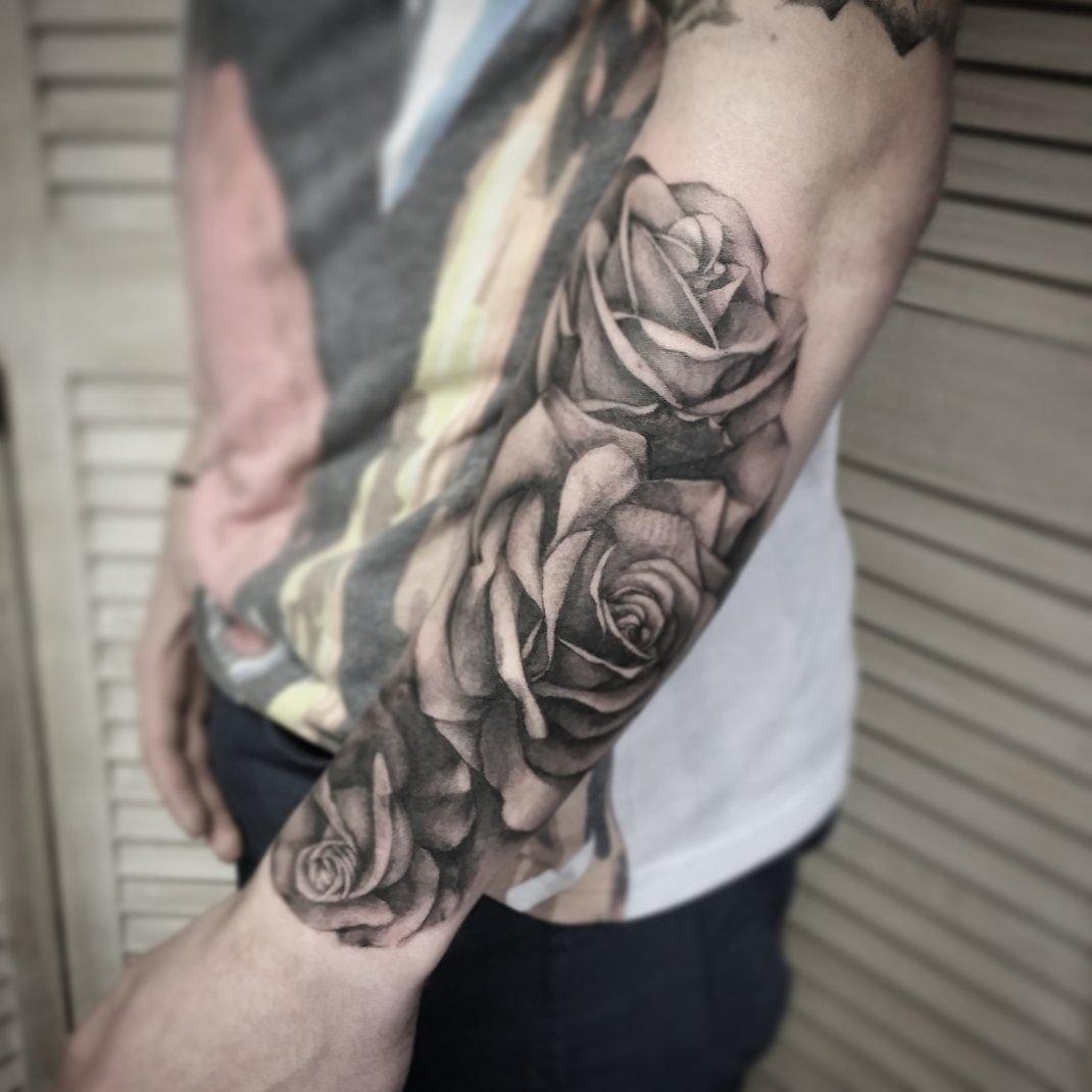 10 Ideal Arm Sleeve Tattoo Ideas For Guys realistic roses half sleeve tattoos black ink tattoos pinterest 1