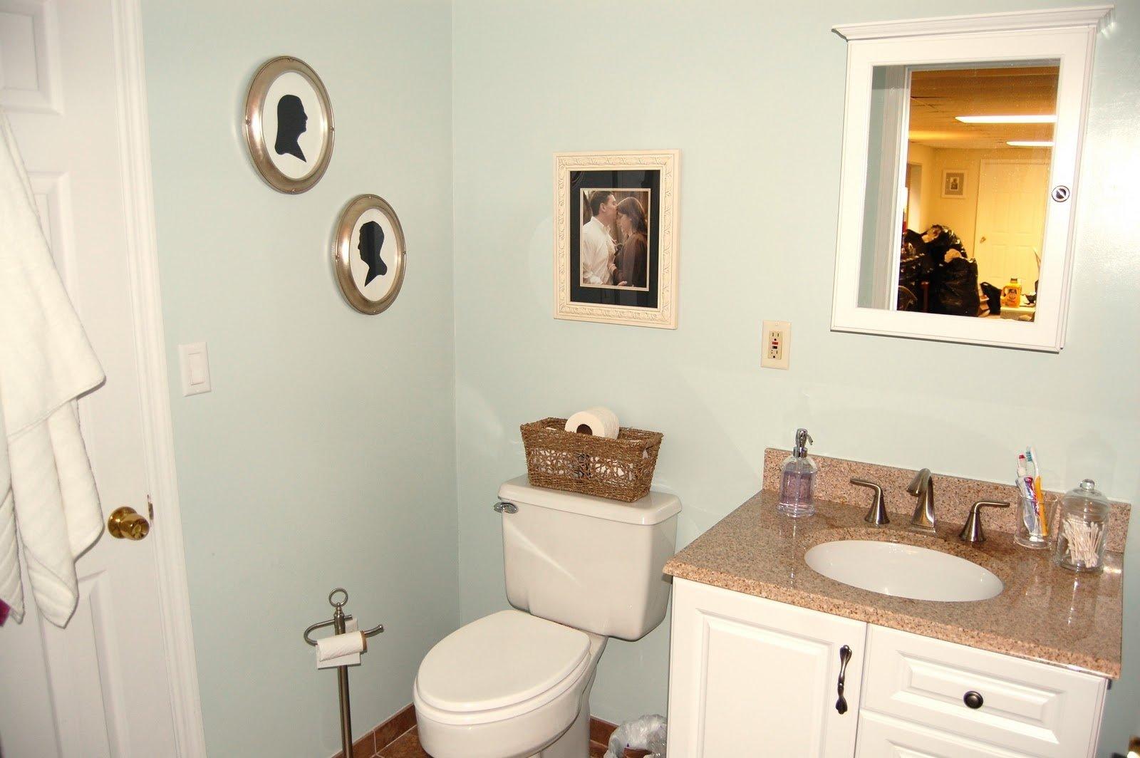 round white ceramic vessel single sink small apartment bathroom