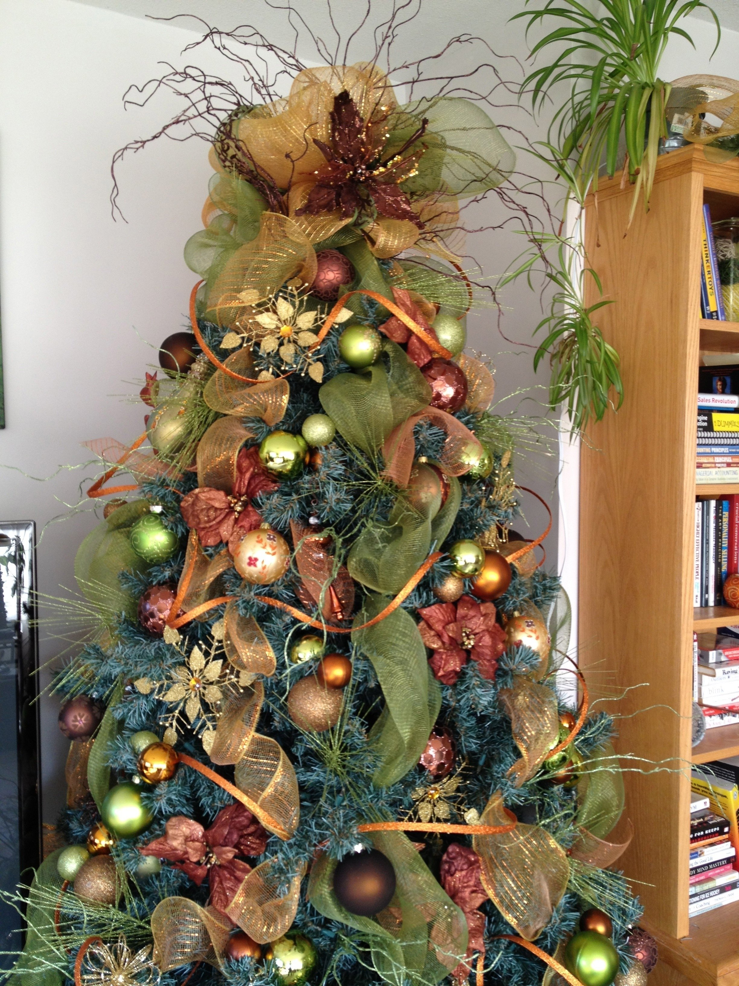 10 Fabulous Decorating With Mesh Ribbon Ideas rustic christmas tree decoration with green mesh ribbon and lighted 2021