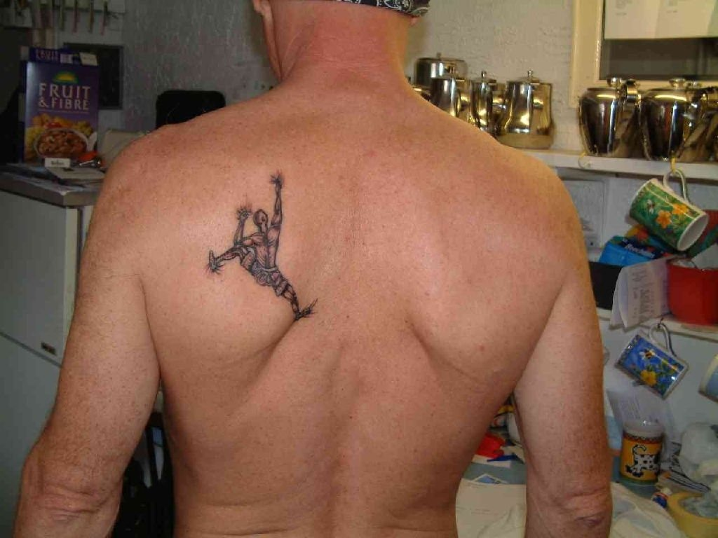 10 Gorgeous Back Tattoo Ideas For Men small arm tattoos for men best tattoo design ideas 2