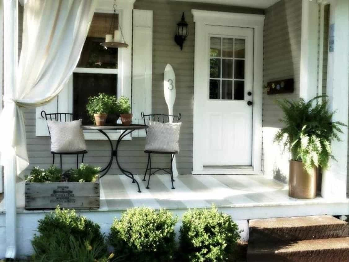 10 Elegant Small Front Porch Decorating Ideas small front porch with curtains and metal furniture also plants 2021