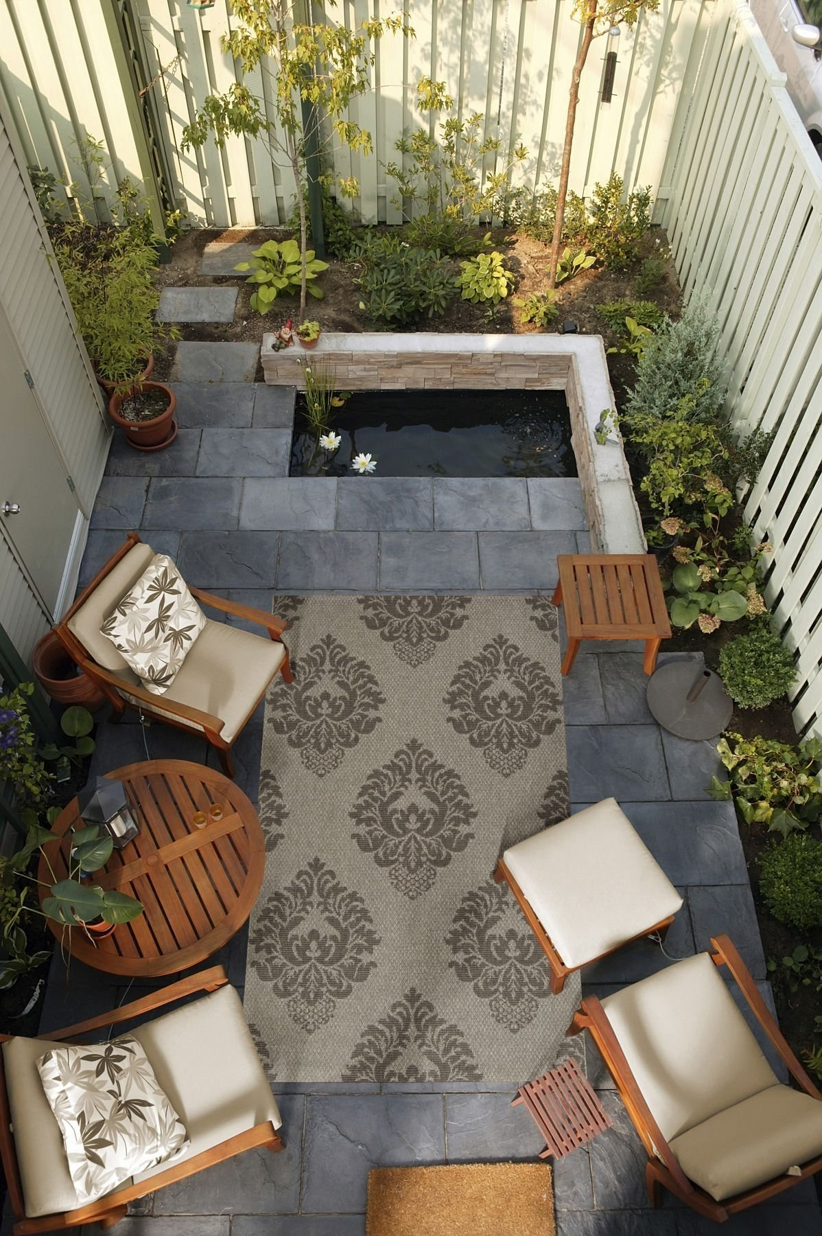 10 Perfect Outdoor Patio Ideas For Small Spaces small outdoor space brought togethera surya rug from the 2020