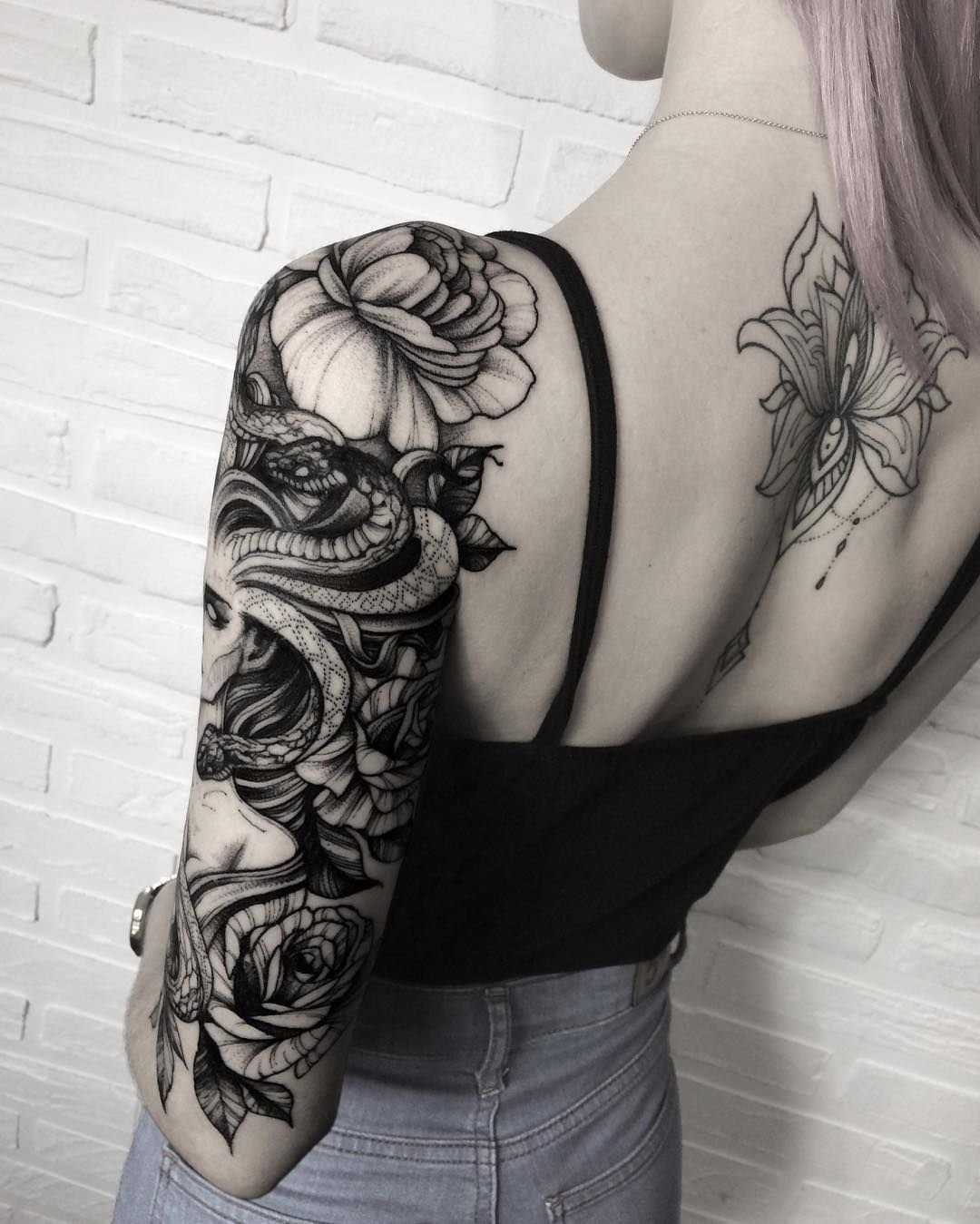 10 Spectacular Sleeve Tattoo Ideas For Girls snake woman sleeve tattoo idea snake tattoos pinterest woman 3 2020
