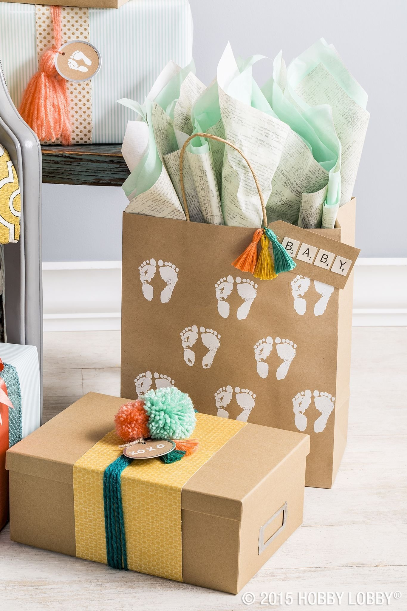 10 Attractive Baby Shower Gift Wrapping Ideas stamp simple brown wrapping boxes and bags for a lovely diy baby 2020
