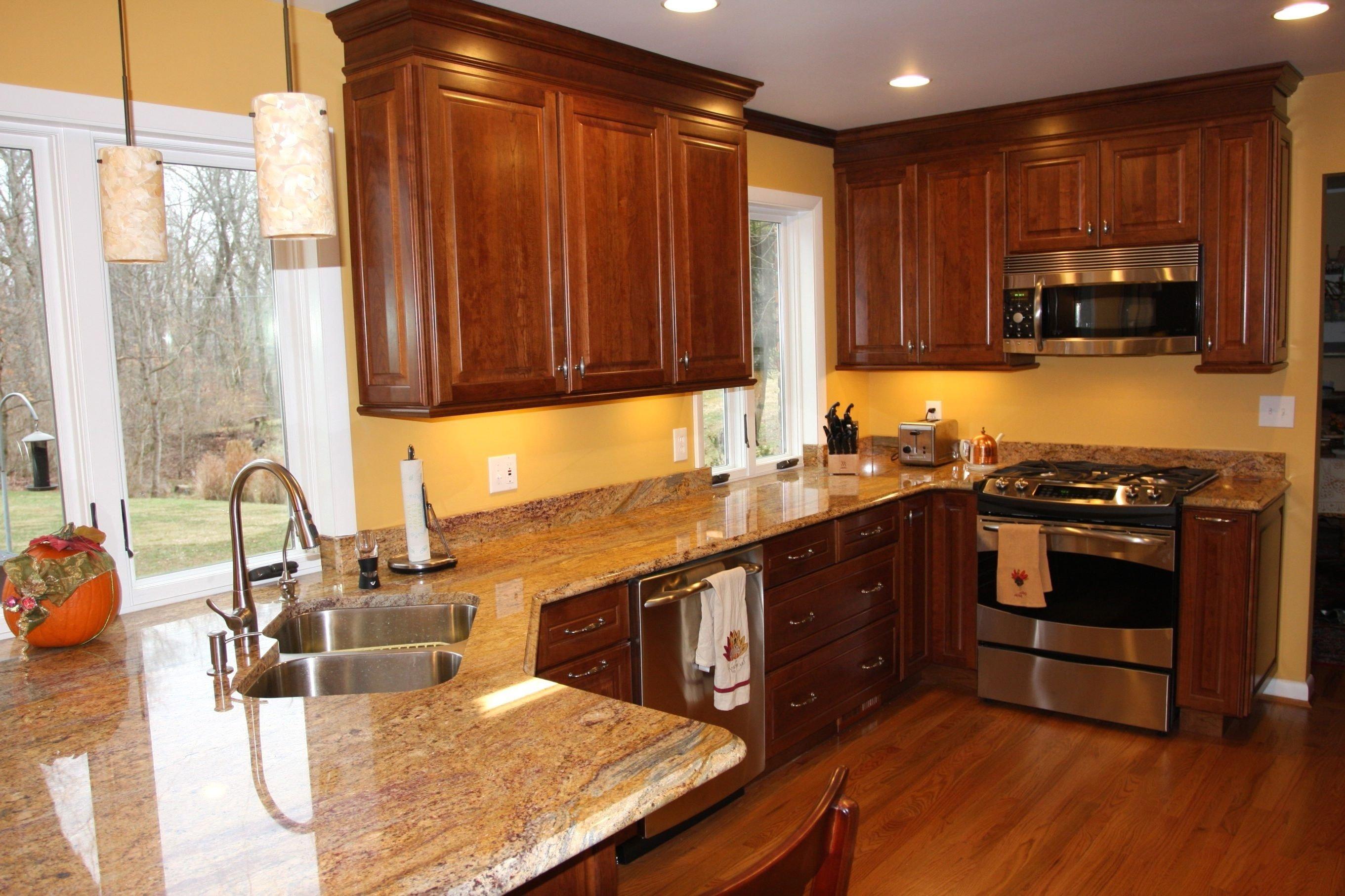 10 Pretty Kitchen Paint Ideas With Dark Cabinets stone countertops kitchen paint colors with dark cabinets lighting 2020